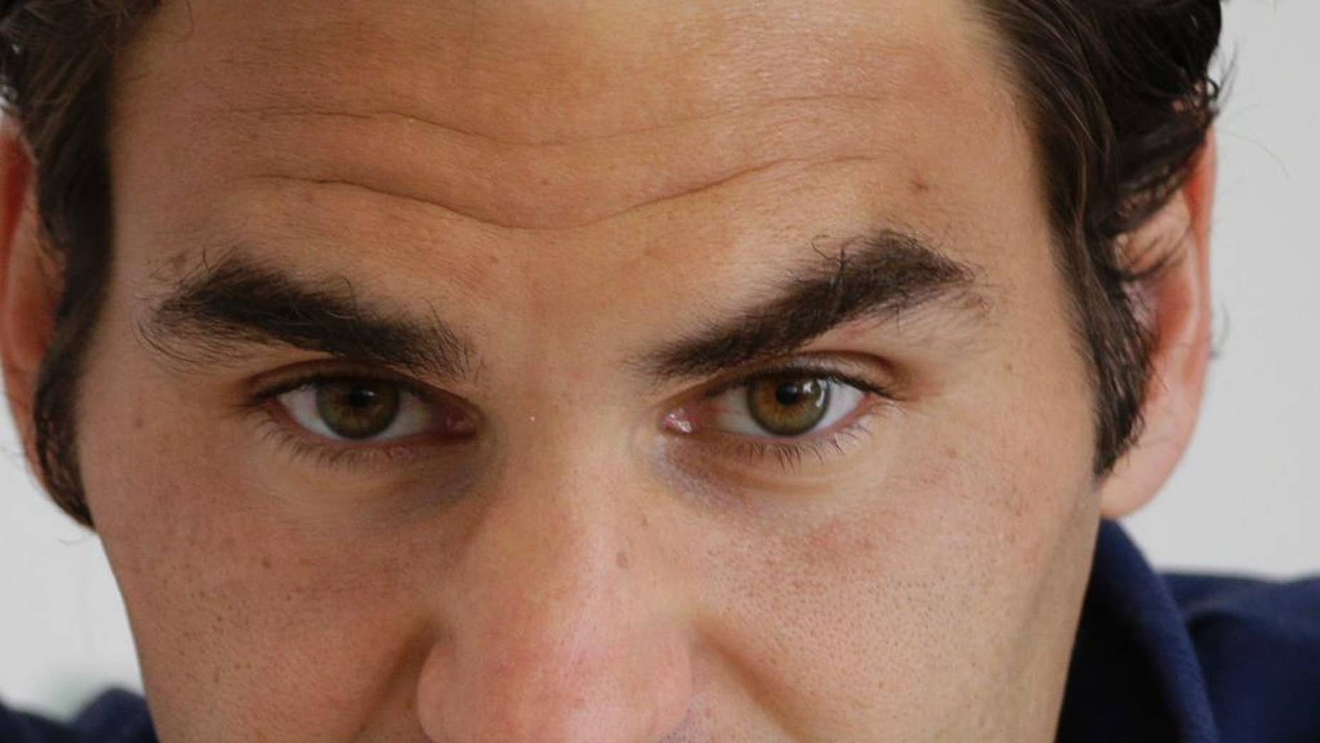 Roger Federer of Switzerland listens to reporters' questions during a press conference at the Italian Open tennis tournament, in Rome, Tuesday, May 13, 2014. (AP Photo/Alessandra Tarantino)