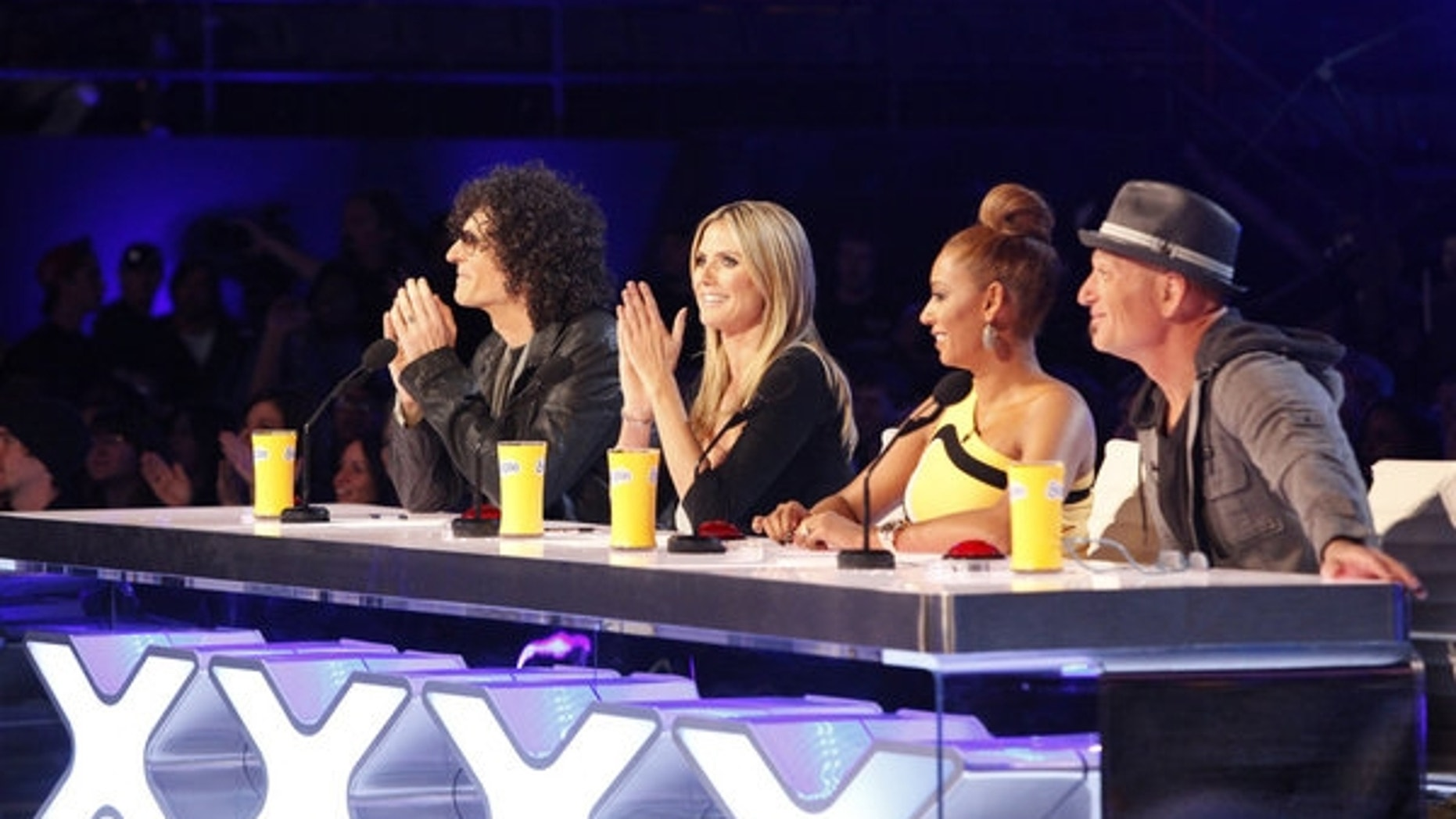 """""""America's Got Talent"""" judges (left to right) Howard Stern, Heidi Klum, Mel B and Howie Mandel are shown."""