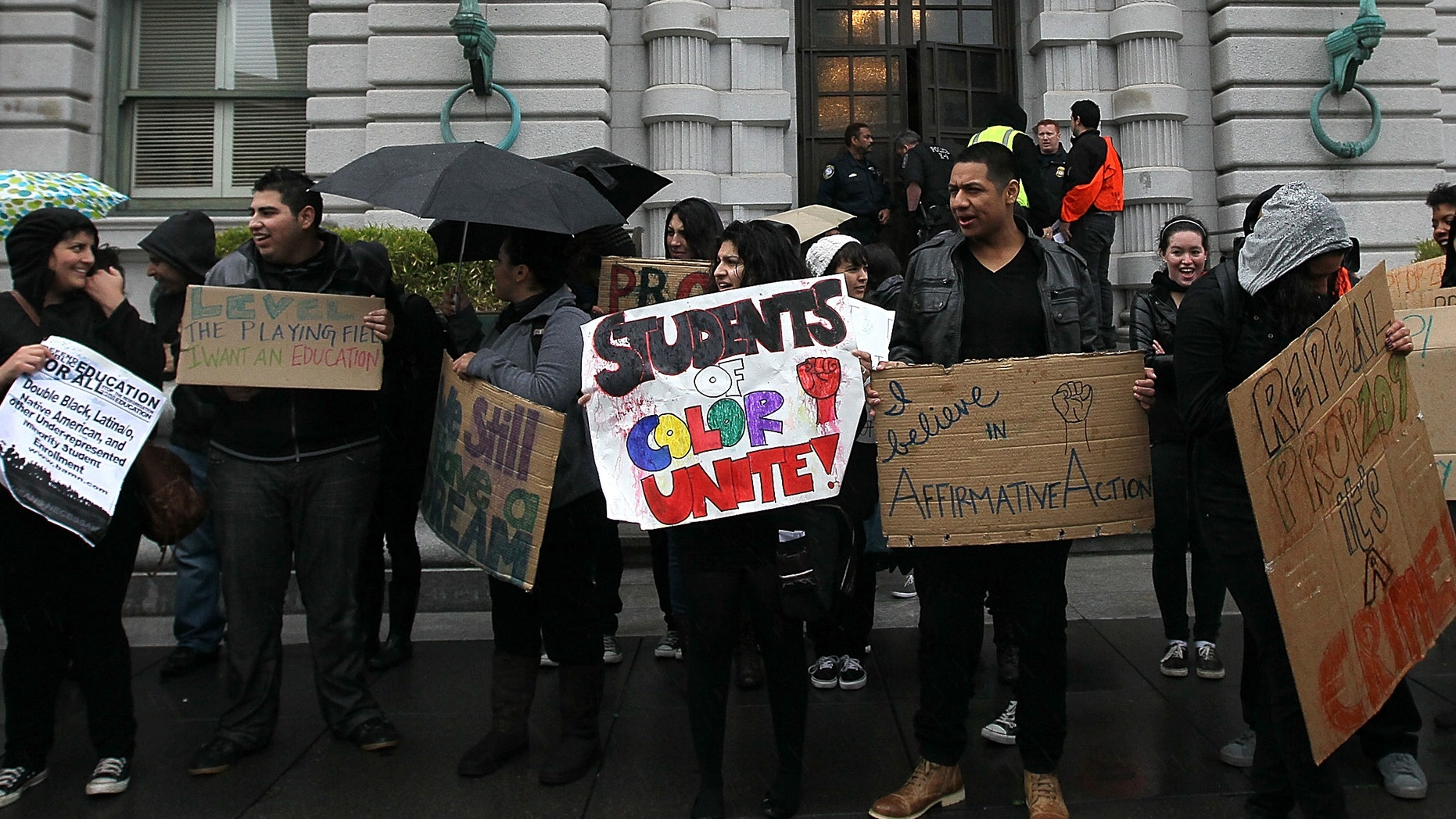 SAN FRANCISCO, CA - FEBRUARY 13:  Students hoping for a repeal of California's Proposition 209 hold signs as they protest outside of the Ninth U.S. Circuit Court of Appeals on February 13, 2012 in San Francisco, California.