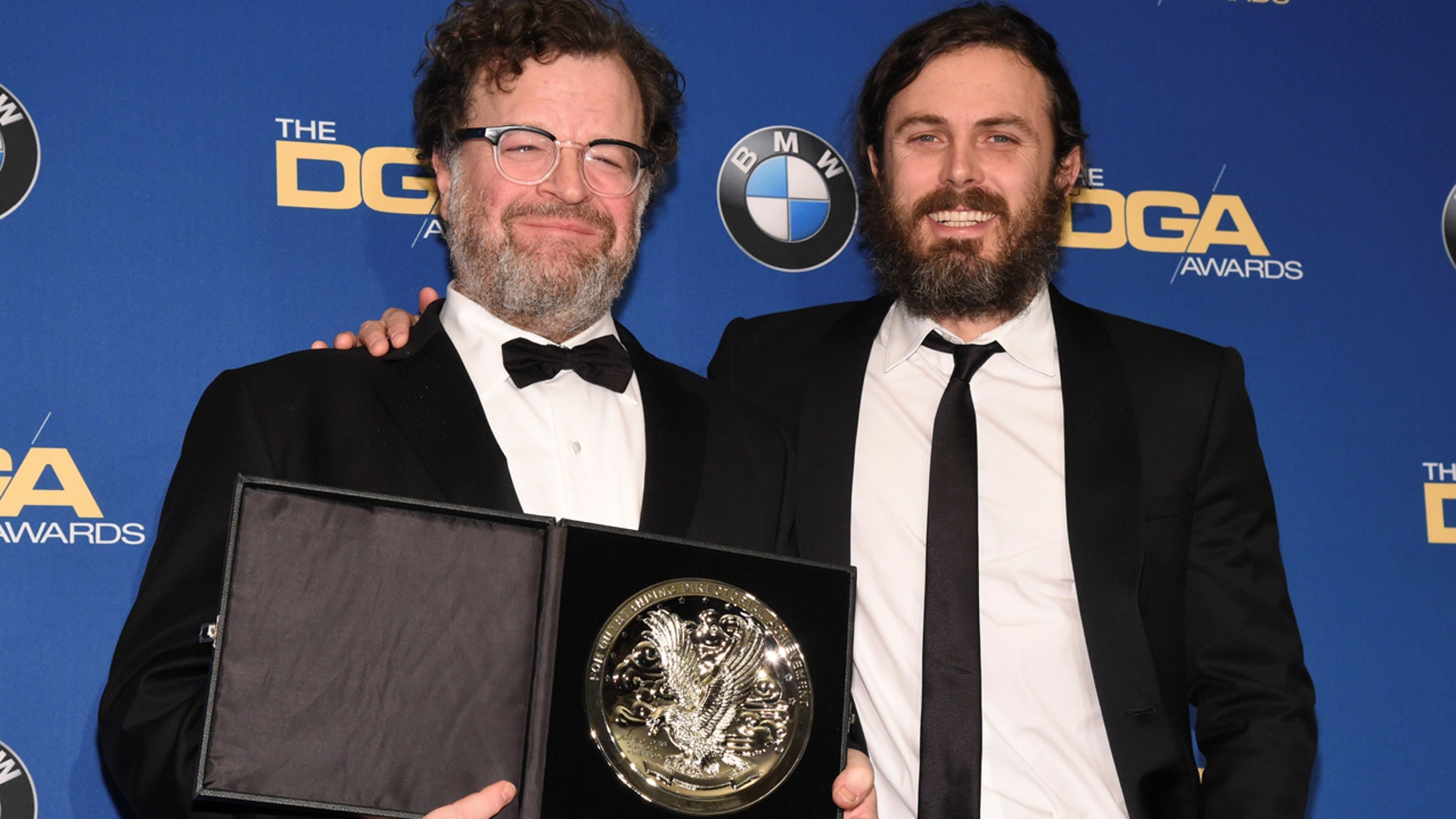 Feature Film Award nominee, Kenneth Lonergan, left, poses for photographers with Casey Affleck, right, at the 69th annual DGA Awards in Beverly Hills, Cali., on February 4, 2017.