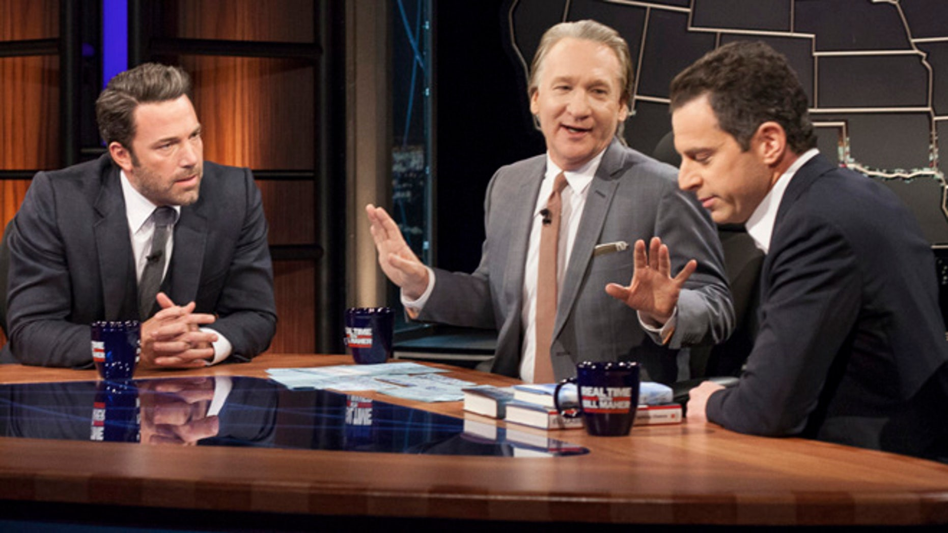 """In this Friday, Oct. 3, 2014, image released by HBO, host Bill Maher, center, talks with actor Ben Affleck, left, and Sam Harris, author of """"Waking Up: A Guide to Spirituality Without Religion"""", during """"Real Time With Bill Maher,"""" in Los Angeles. (AP Photo/HBO) ORG XMIT: NY114"""