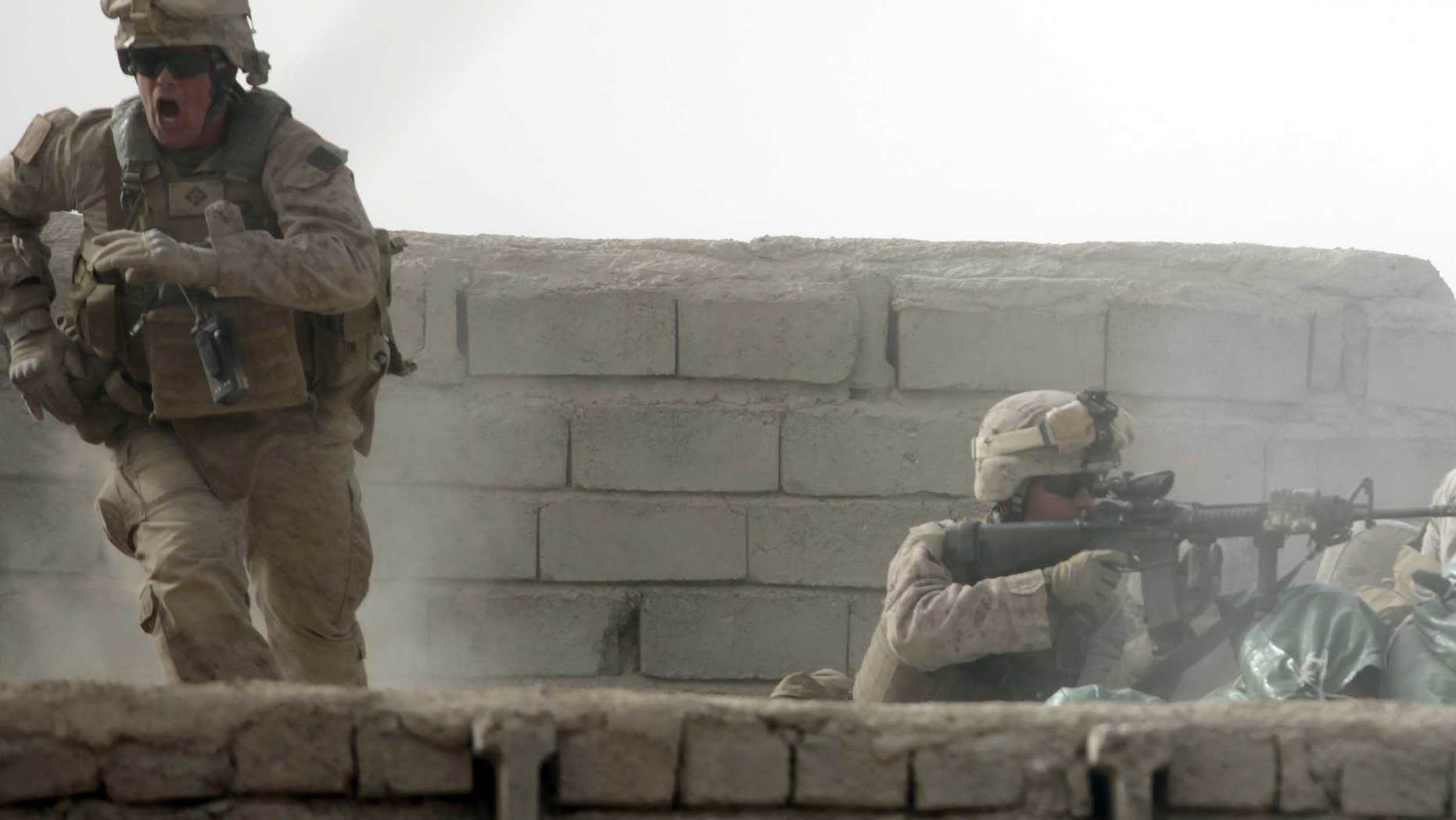 Feb. 14: A U.S. Marine from Bravo Company of the 1st Battalion, 6th Marines runs during a heavy gun battle in the town of Marjah, Afghanistan.