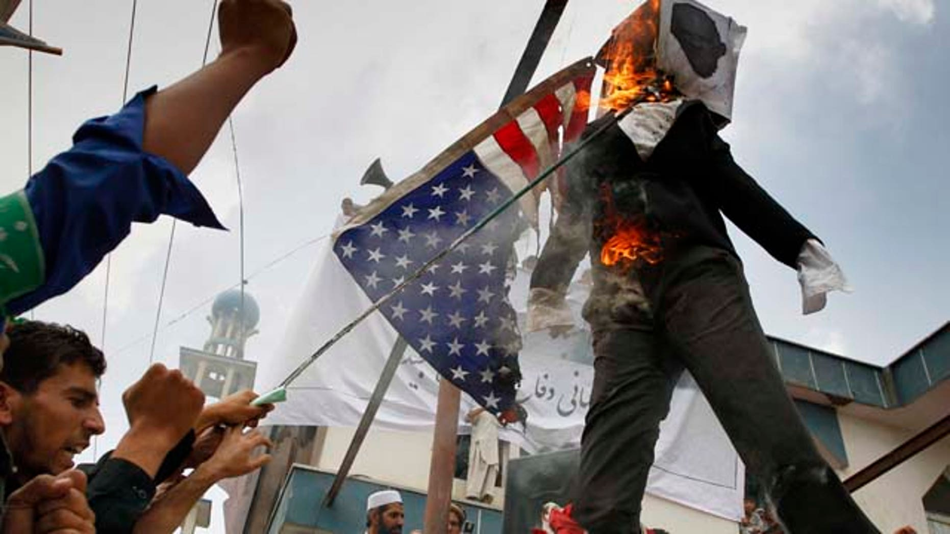Sept. 6: Afghans burn an effigy of Dove World Outreach Center's pastor Terry Jones during a demonstration against the United States in Kabul, Afghanistan. Hundreds of Afghans railed against the U.S. and called for President Barack Obama's death at a rally in the capital Monday to denounce the American church's plans to burn the Islamic holy book on 9/11.