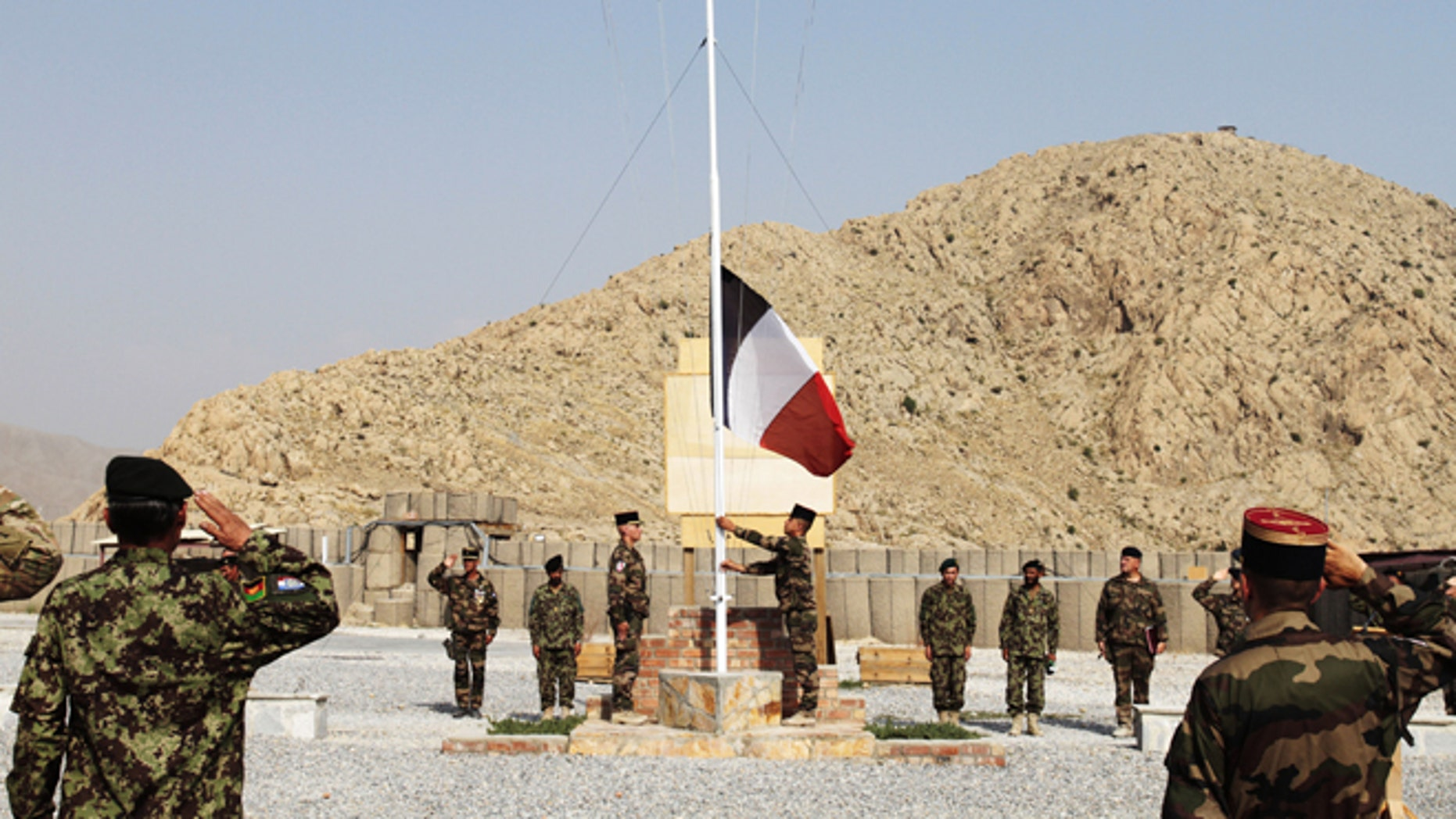 July 31, 2012: French national flag is lowered during a transfer of authority ceremony in Surobi, east of Kabul, Afghanistan.