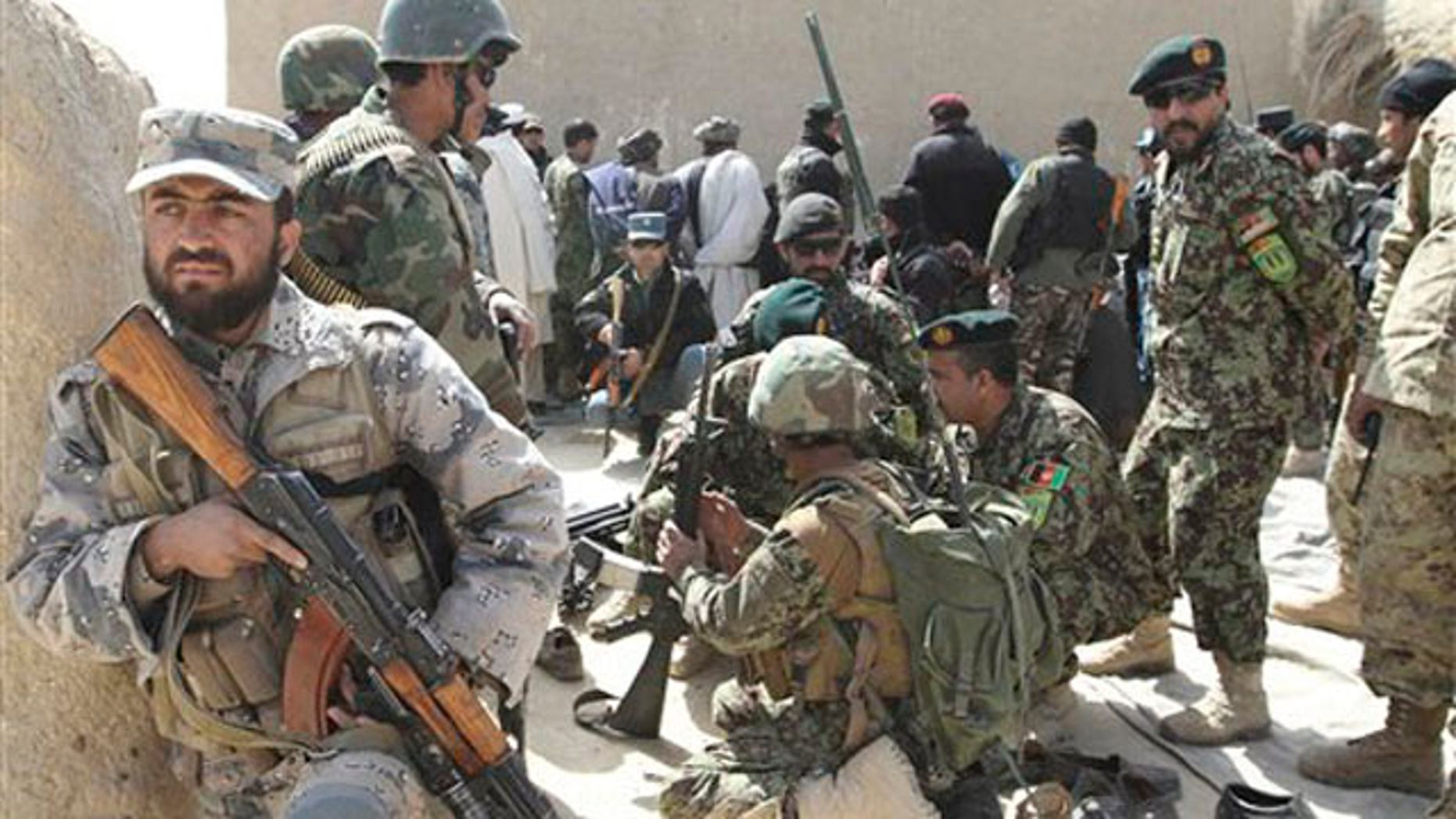 March 13, 2012: Afghan security forces are seen after Taliban militants opened fire on a delegation of senior Afghan officials in Panjwai, Kandahar province south of Kabul, Afghanistan.