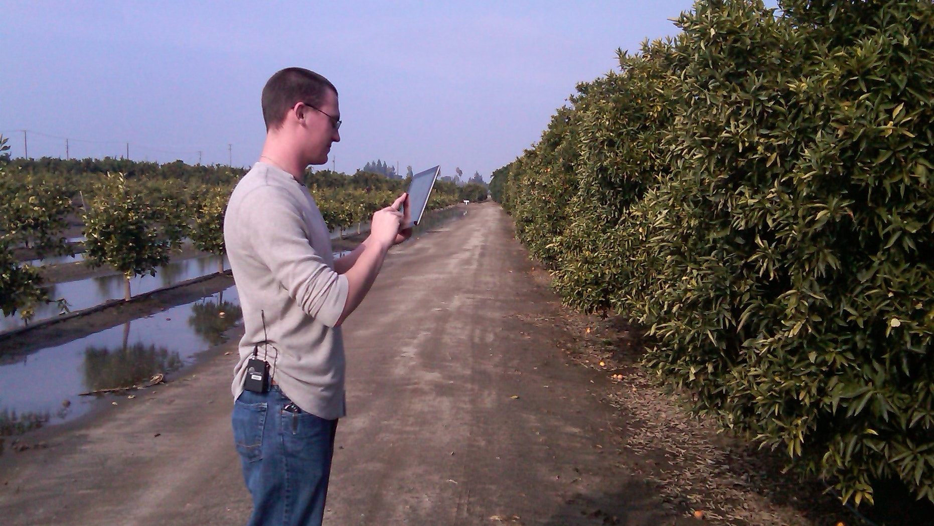 SFC Jarrod Mattison with the US Army Reserve, using an app to learn more about the crops he'll encounter in Afghanistan.