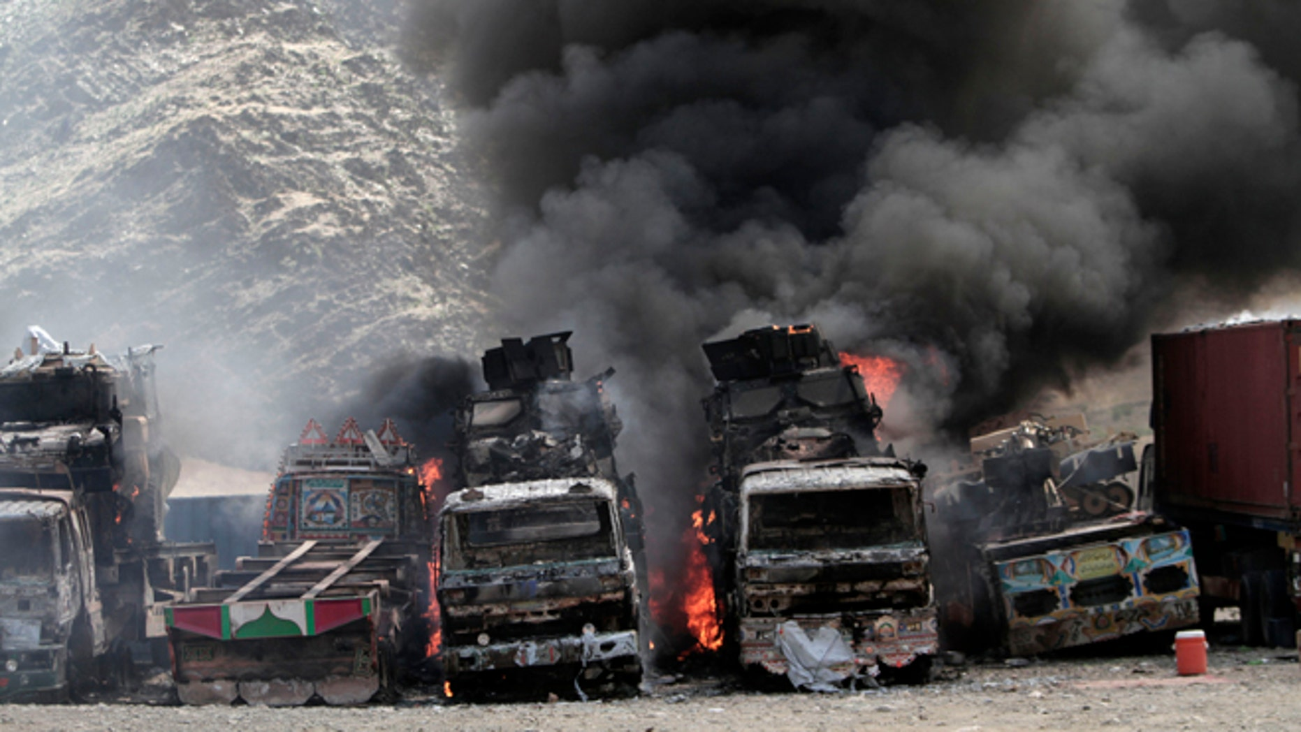 Sept. 2, 2013: Smoke rises from  NATO supply trucks following an attack by militants in the Torkham area near the Pakistan-Afghanistan border in Jalalabad province east of Kabul, Afghanistan. The Taliban claimed responsibility for the strike on a U.S. base in Afghanistan near the border with Pakistan on Monday, setting off bombs, torching vehicles and shutting down a key road used by NATO supply trucks, officials said. Several people -- apparently all attacking insurgents -- were killed.  (AP/Rahmat Gul)