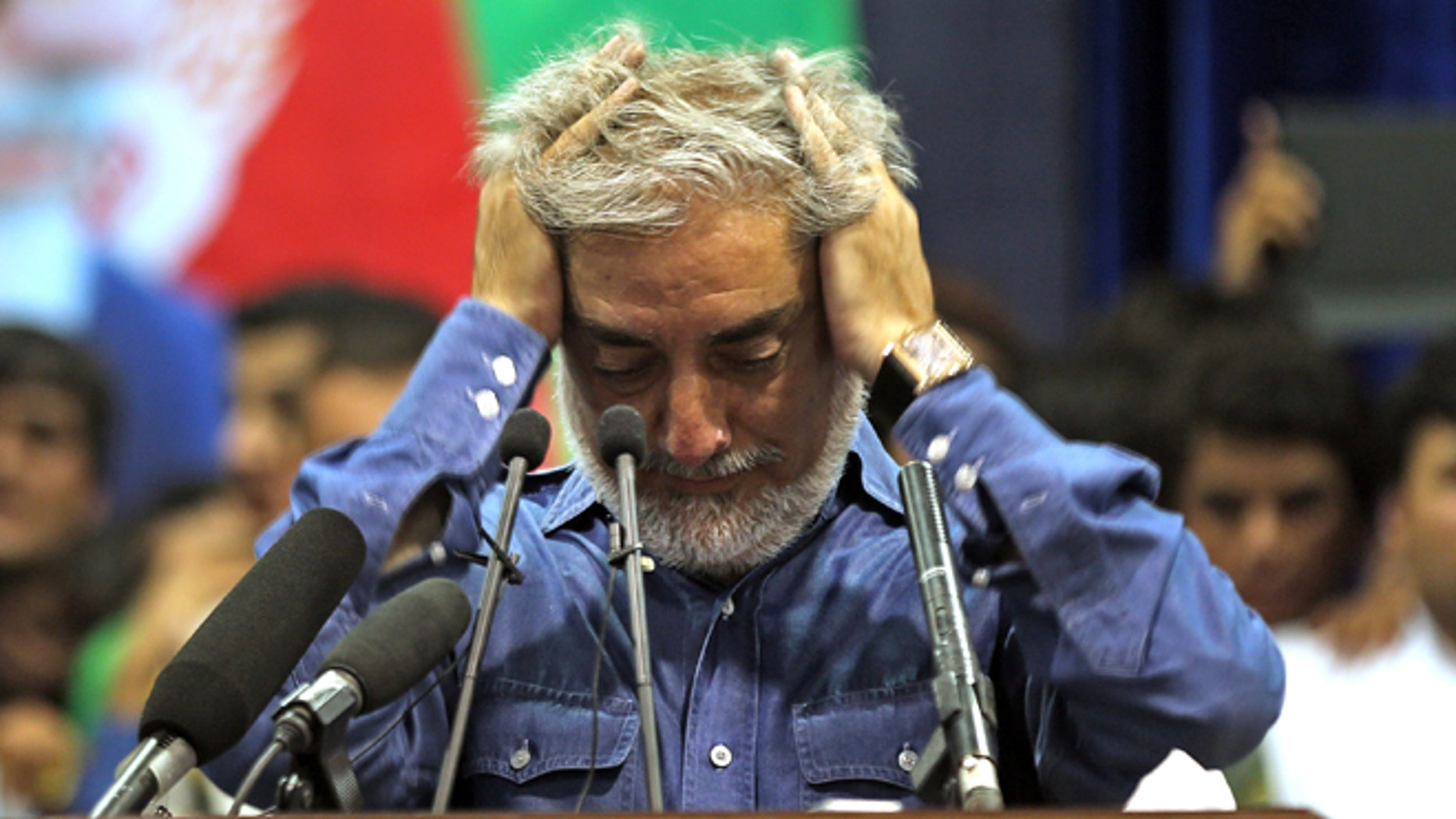 July 8, 2014: Afghan presidential candidate Abdullah Abdullah runs his hands through his hair as he pauses in addressing his supporters in Kabul, Afghanistan. (AP)