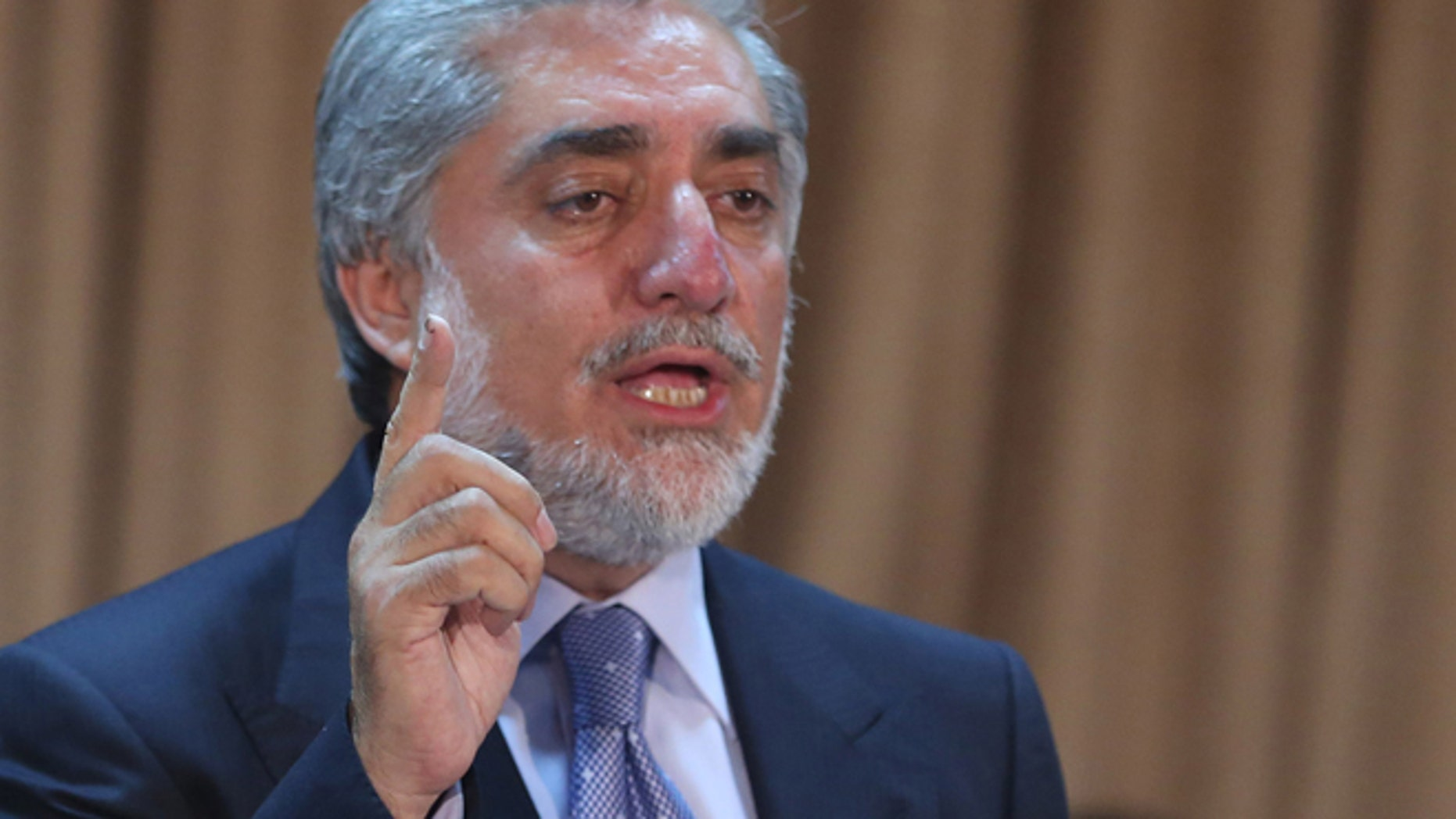 Afghanistan's presidential candidate Abdullah Abdullah speaks during a news conference in Kabul, Afghanistan, Sunday, June 15, 2014. The two candidates, former Foreign Minister Abdullah Abdullah and former Finance Minister Ashraf Ghani Ahmadzai, have both vowed to improve ties with the West. (AP Photo/Massoud Hossaini)