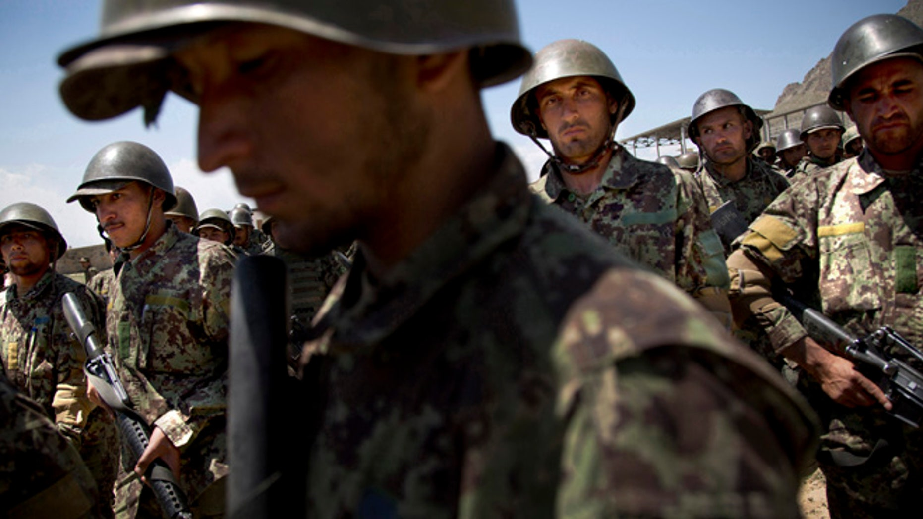 May 8, 2013: In this file photo, Afghan Army soldiers gather at a training facility in the outskirts of Kabul, Afghanistan.