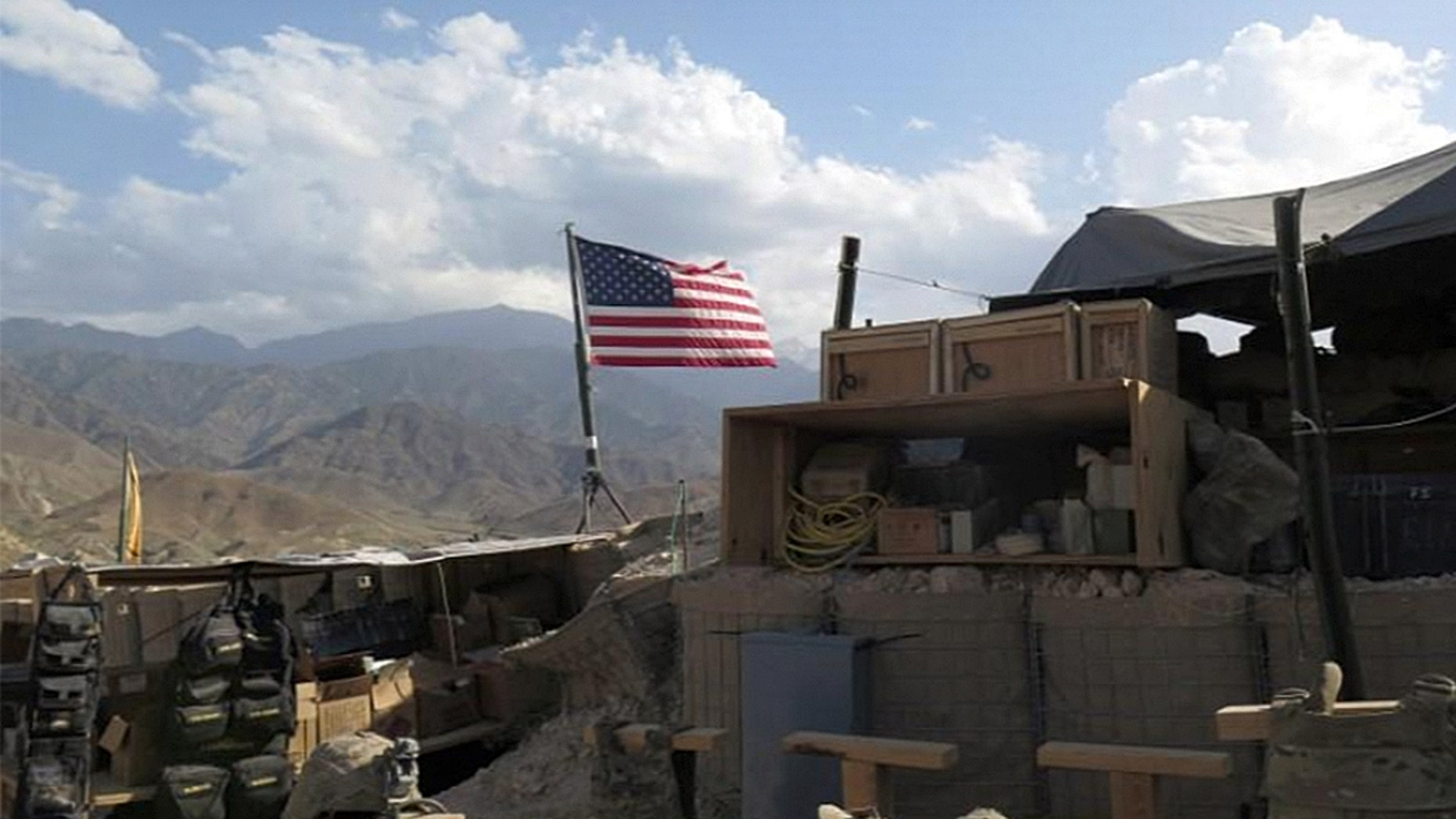 A U.S. flag is seen at a post in Deh Bala district, Nangarhar province, Afghanistan after the area was recaptured from ISIS fighters.