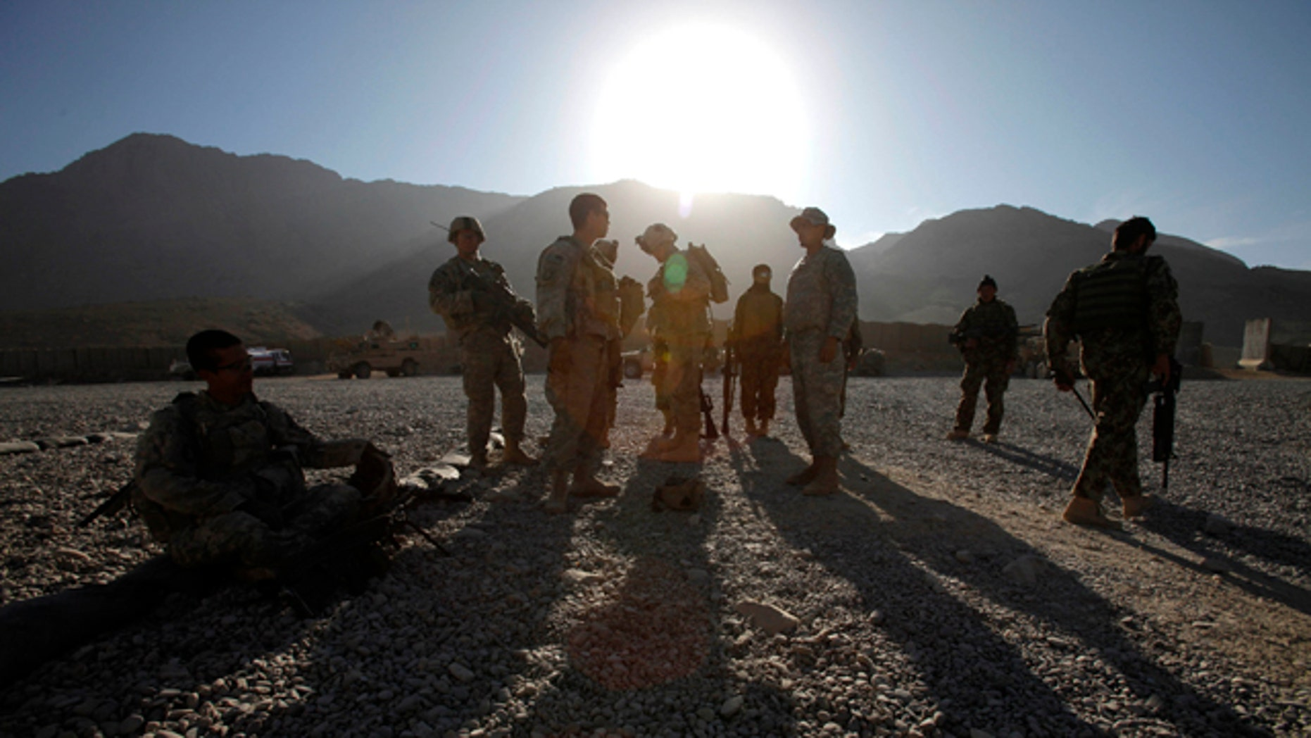 Nov. 22: U.S. Army soldiers and Afghan policemen prepare themselves for a foot patrol in West Now Ruzi village, district Panjwai, in Afghanistan.