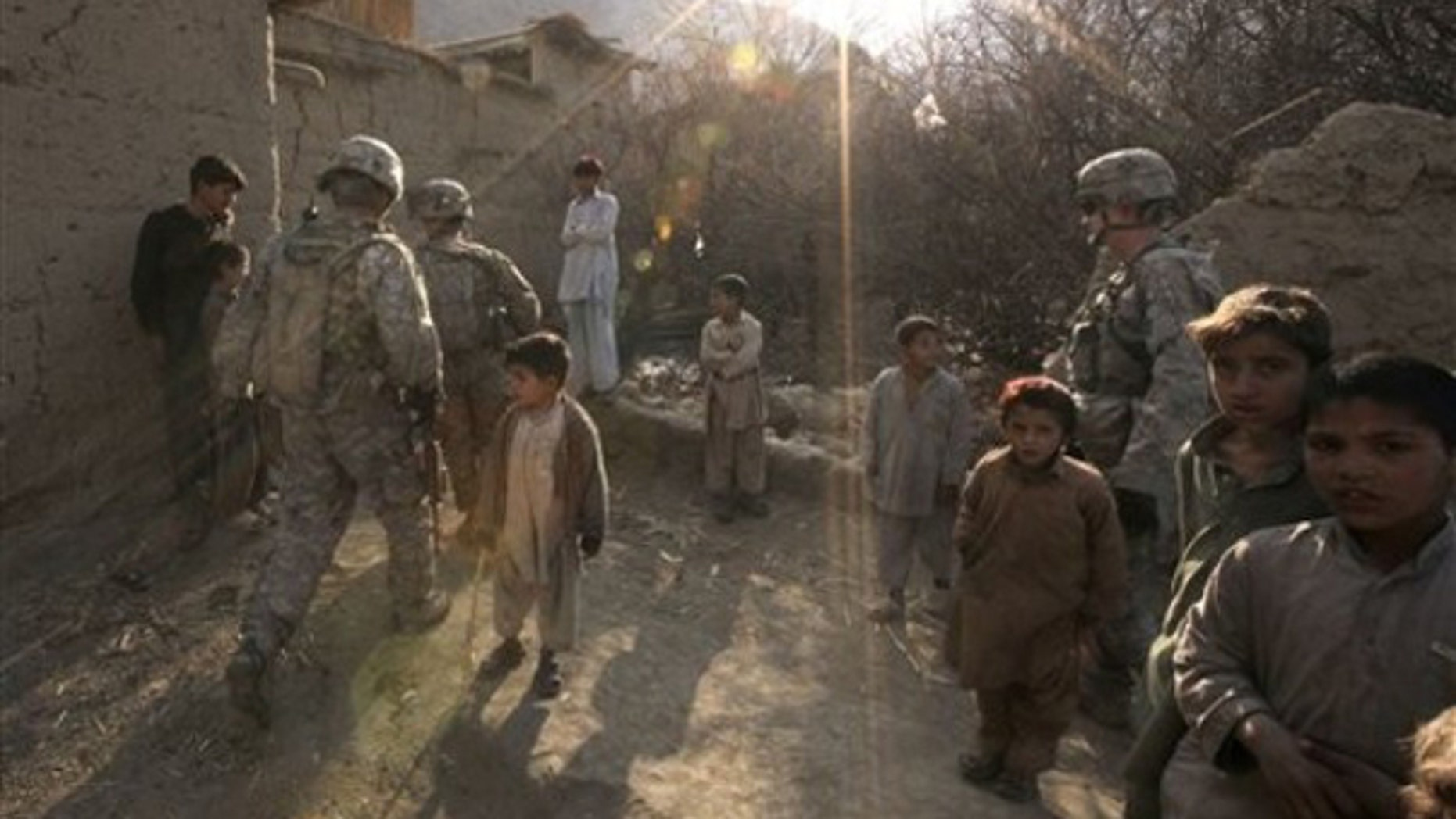 Sunday: U.S. Army soldiers patrol inside Pech Valley, Kunar province, in northeastern Afghanistan. Private consultants Checchi & Company won a no-bid contract from the Obama administration to 'train the next generation of legal professionals' in Afghanistan. (AP)