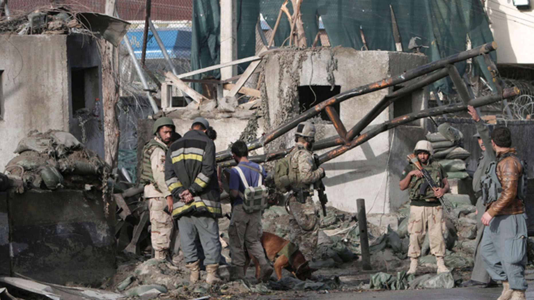 March 26, 2013: Afghan police and U.S. forces arrive to the scene after eight suicide bombers attacked a police headquarters in the eastern Afghan city of Jalalabad, Afghanistan, killing five police officers and wounding four others,  a security official said. An insurgent in a bomb-laden car detonated his vehicle in front of the Jalalabad Police Quick Reaction Force to start the attack, and another seven attackers wearing bomb vests then stormed the compound.