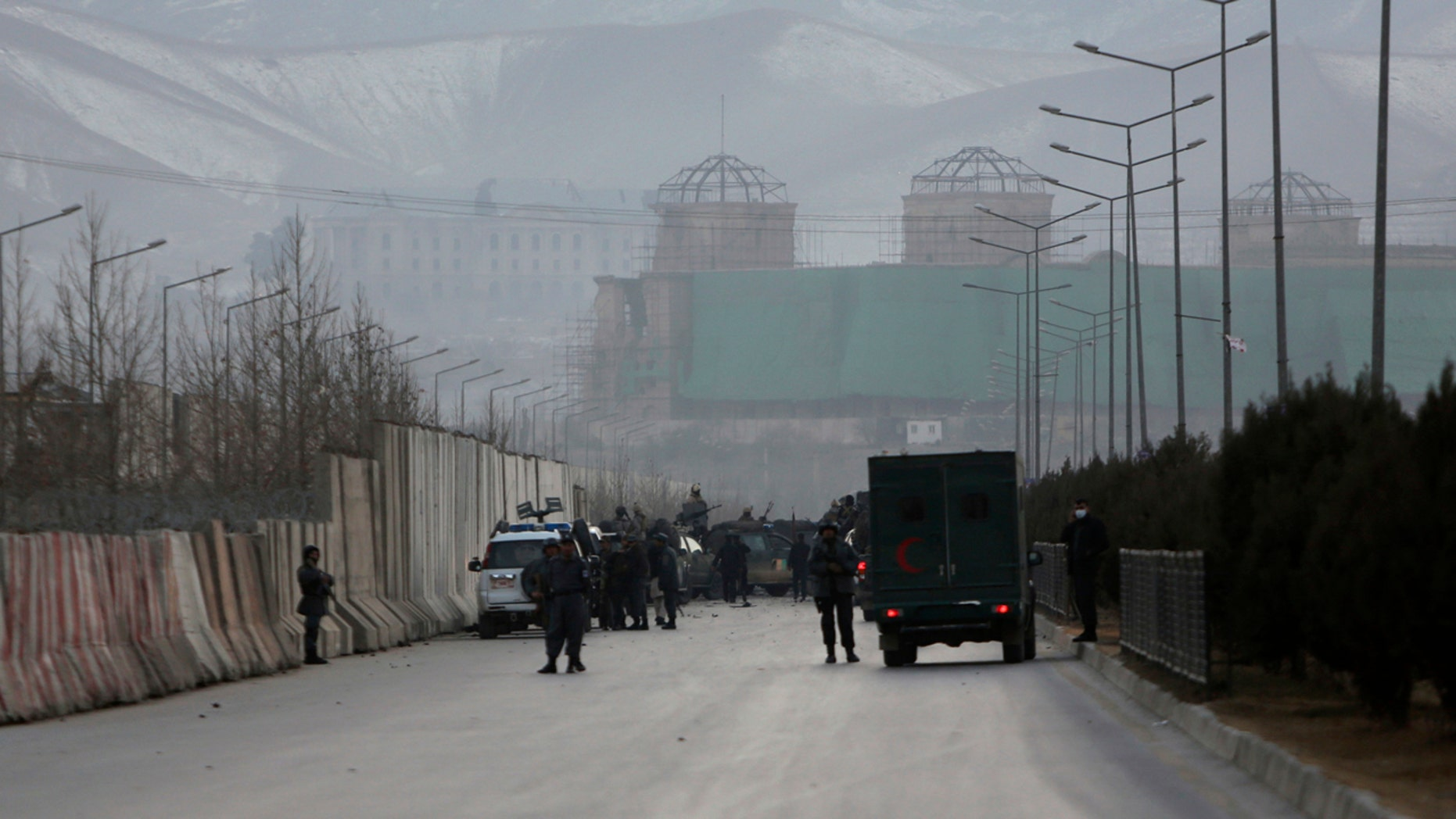 Afghan security forces inspect the site of two large bombings in Kabul, Afghanistan, Tuesday, Jan. 10, 2017.