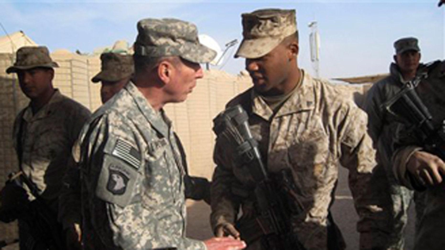 Dec. 25, 2010: Gen. David Petraeus, left, top U.S. and NATO commander in Afghanistan, meets U.S. marines during his visit to Marjah, Afghanistan.