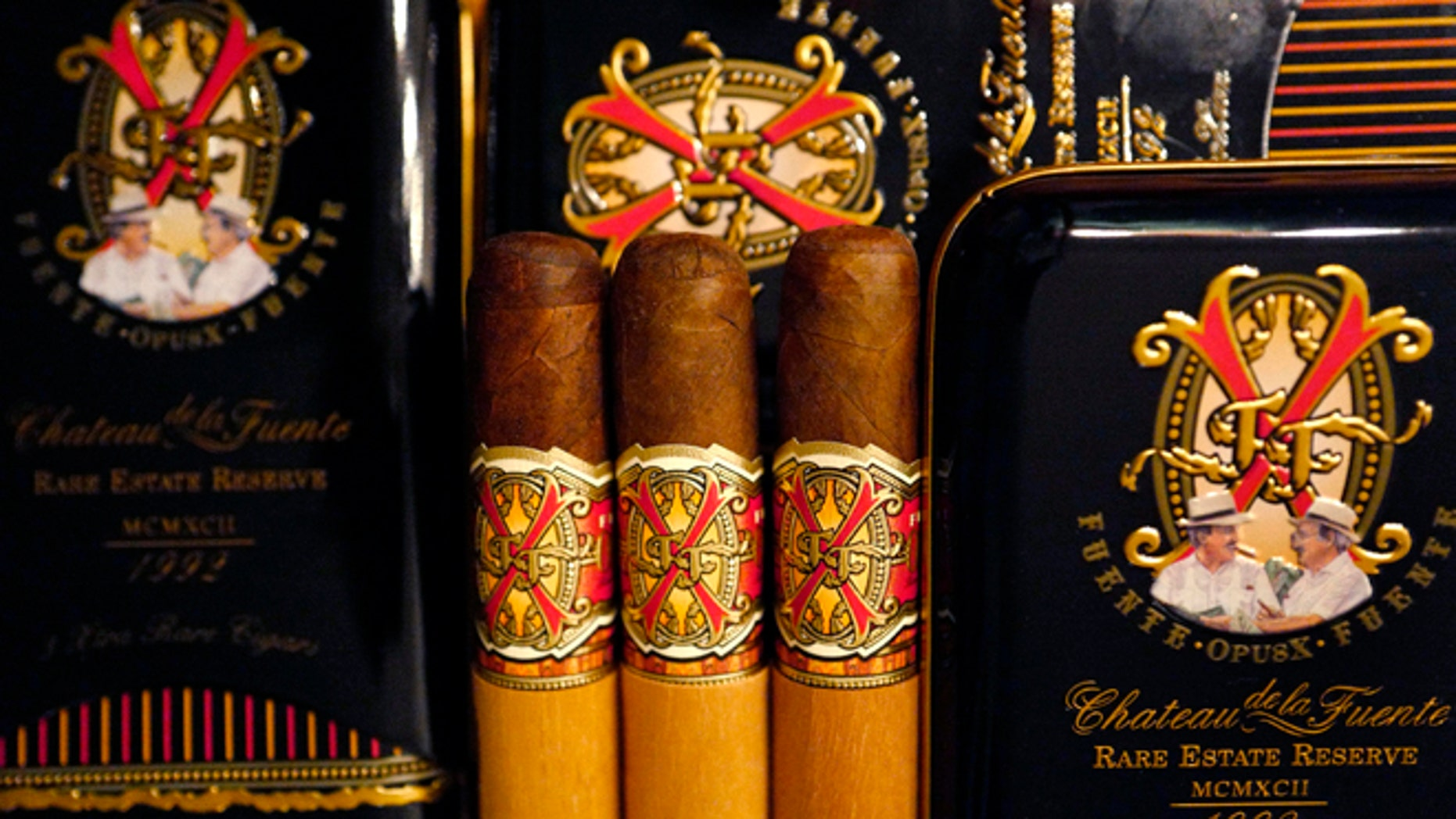 """A selection of rare """"Opus X"""" cigars made in the Domenican Republic by Arturo Fuente are on display at the duty free shop of Atatuerk airport in Istanbul, Turkey, March 25, 2016.    REUTERS/Kai Pfaffenbach  - RTSCN6I"""