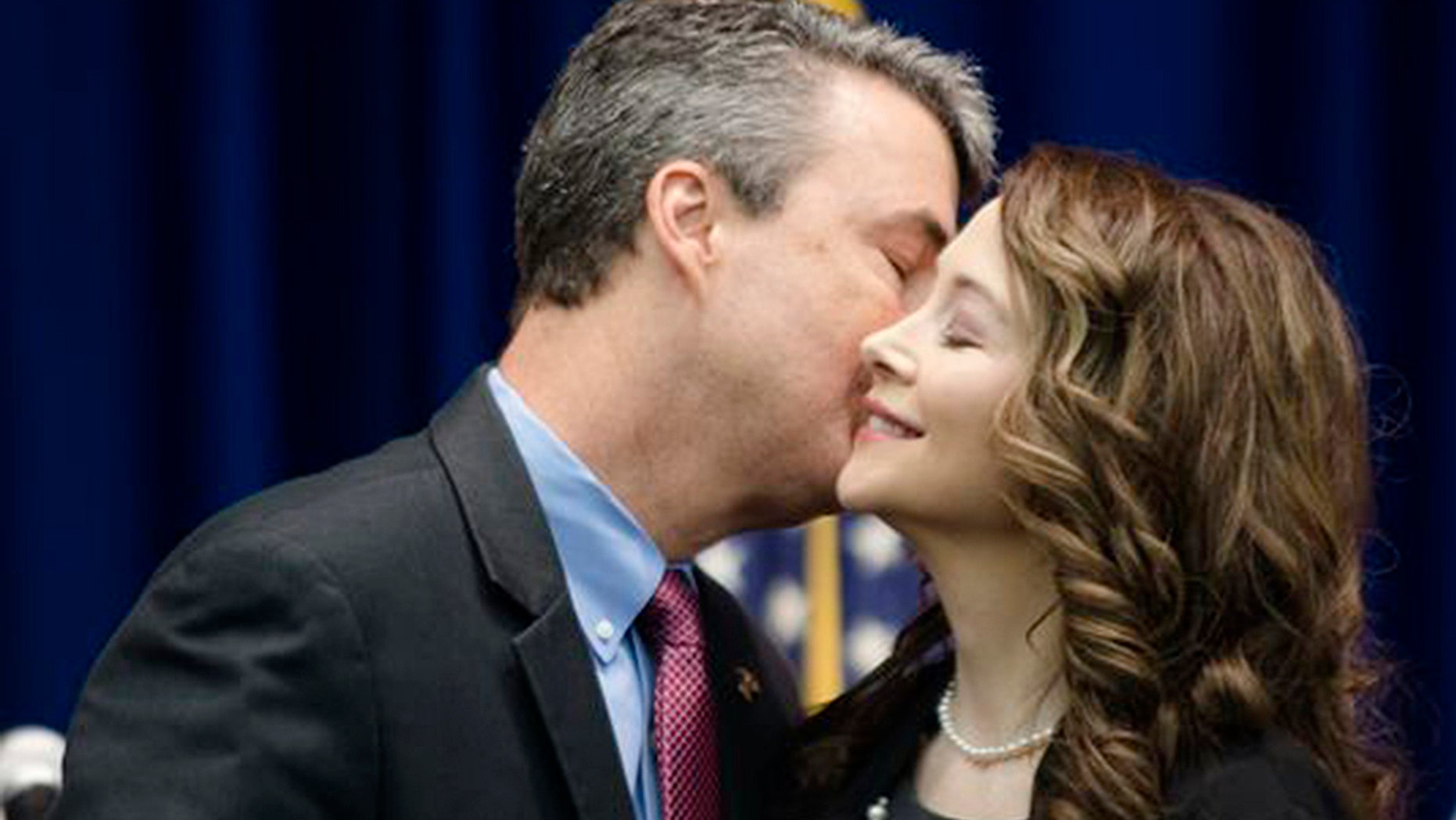 In this Feb. 13, 2017 photo, Alabama Attorney General Steve Marshall kisses his wife, Bridgette, after being sworn into office in Montgomery, Ala.