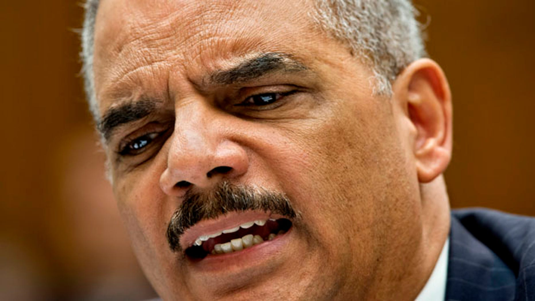 May 15, 2014: Attorney General Eric Holder reacts to aggressive questioning from Rep. Darrell Issa, R-Calif. as he testifies on Capitol Hill in Washington. (AP)
