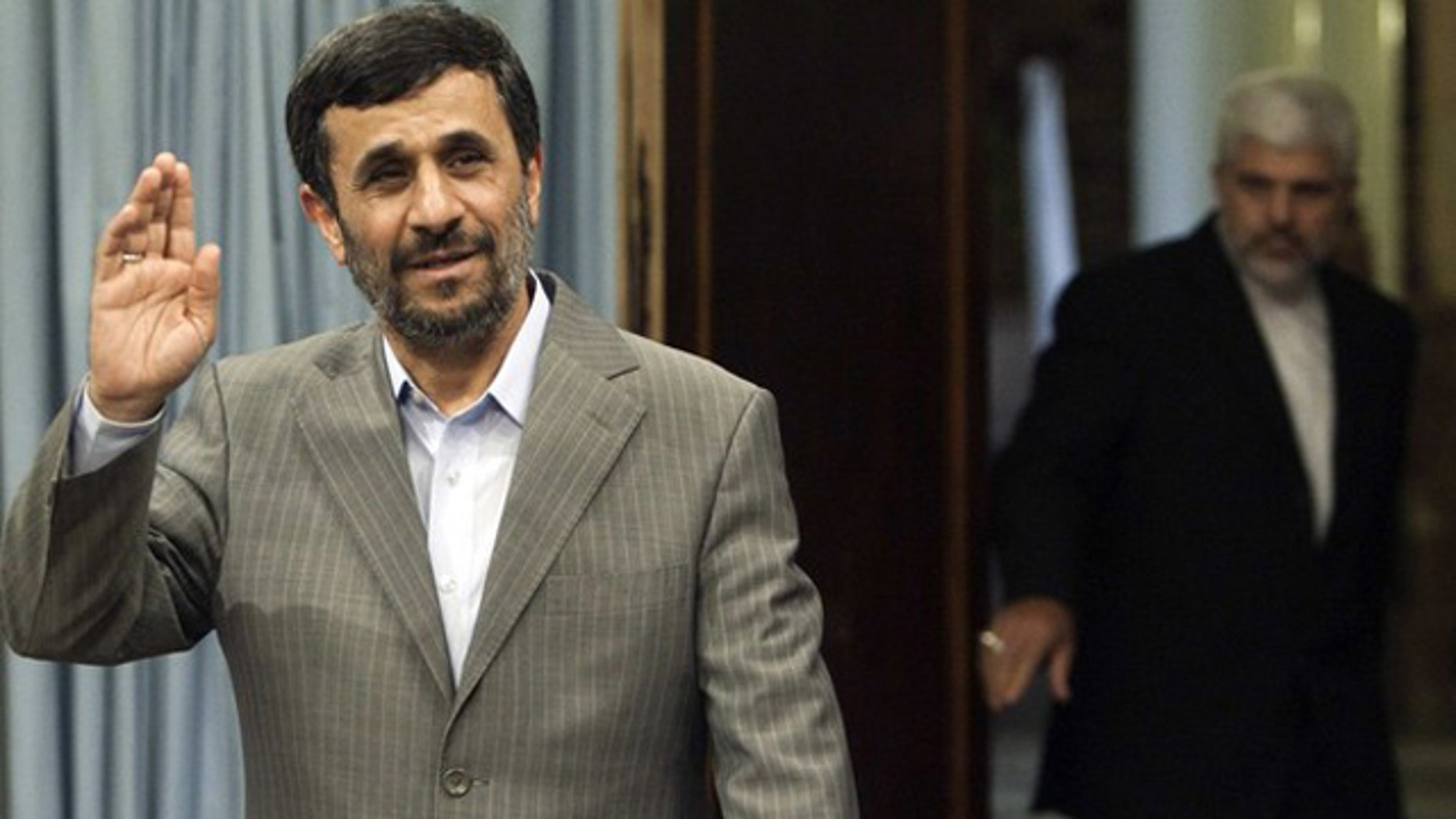 July 15: Iran's President Mahmoud Ahmadinejad arrives for an official meeting in Tehran.