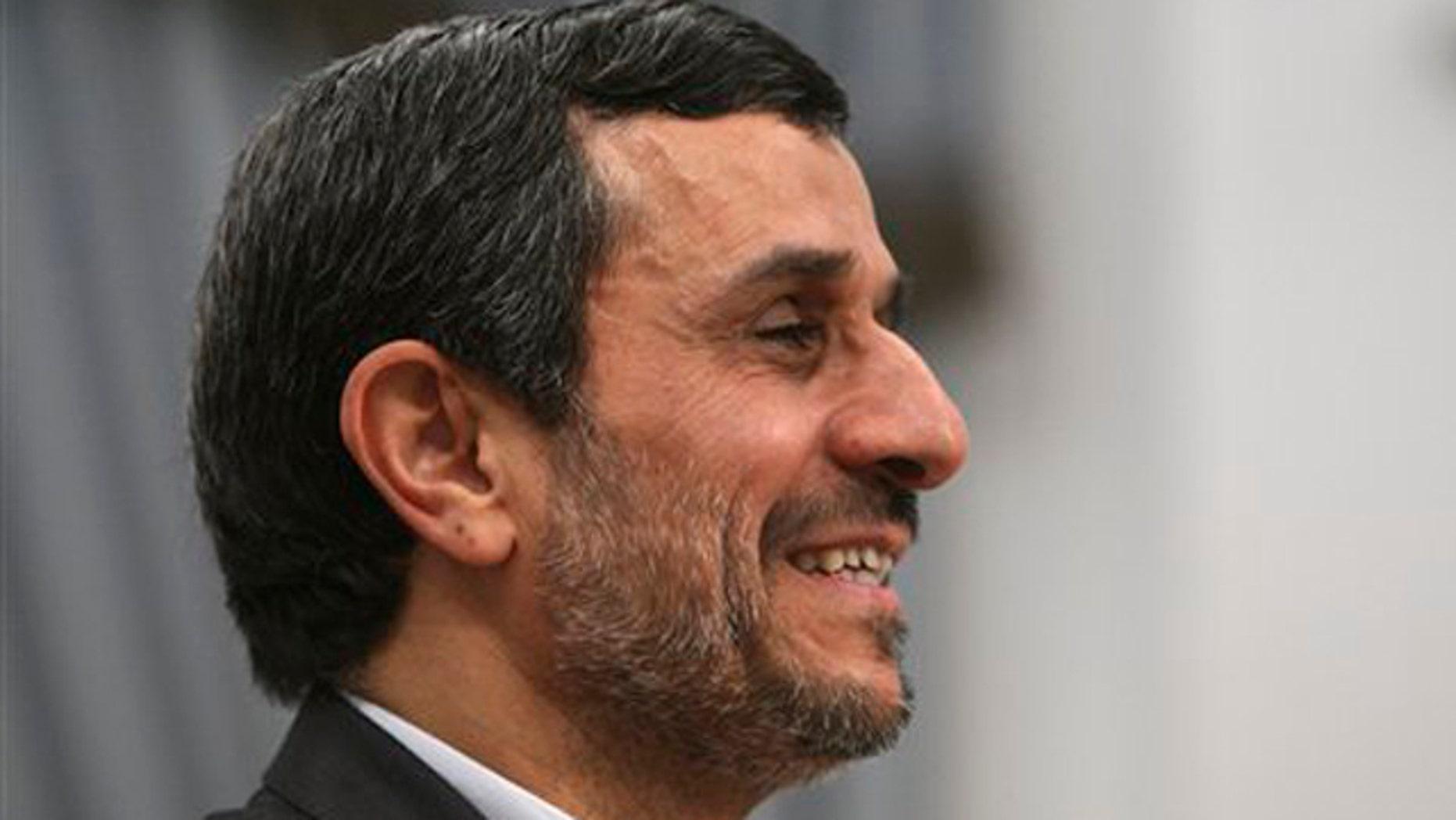 Dec. 13, 2011: Iranian President Mahmoud Ahmadinejad, smiles, prior to a meeting at the presidency office in Tehran, Iran.