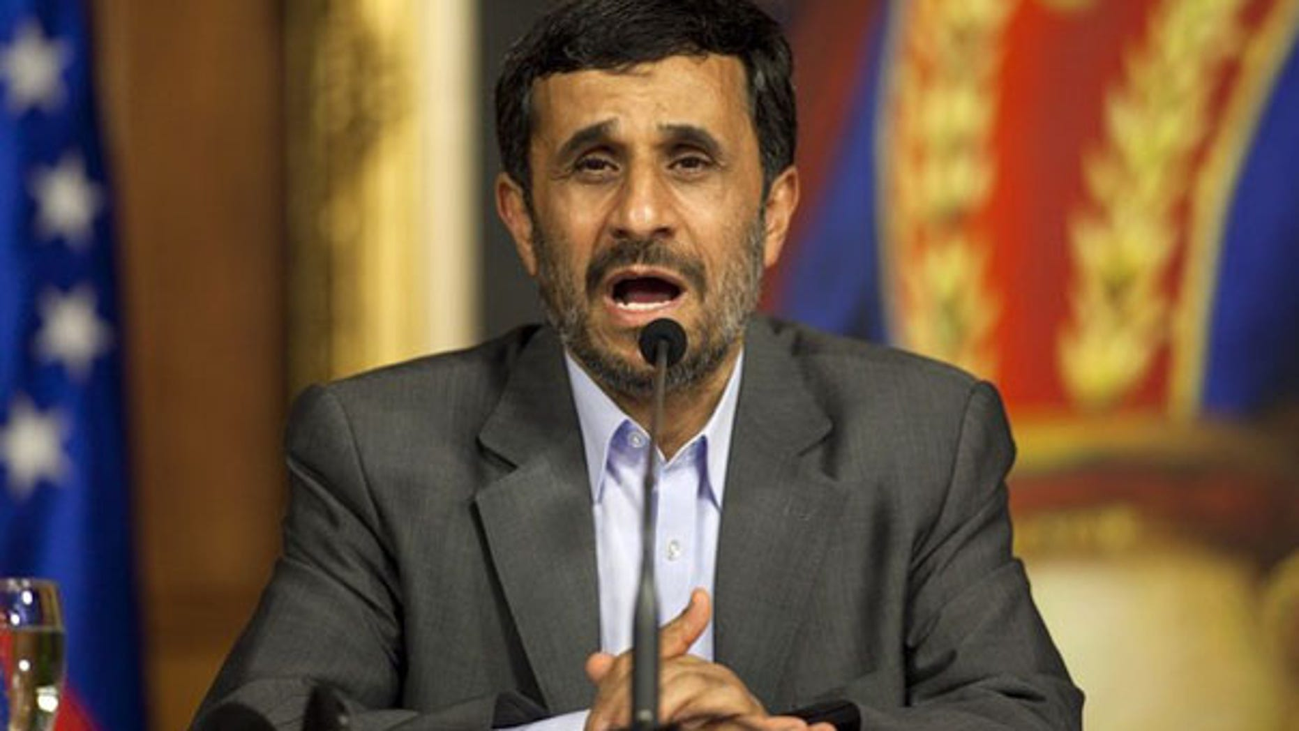 Iran President Mahmoud Ahmadinejad talks to the media in Caracas, Venezuela, Nov. 25. (Reuters Photo)