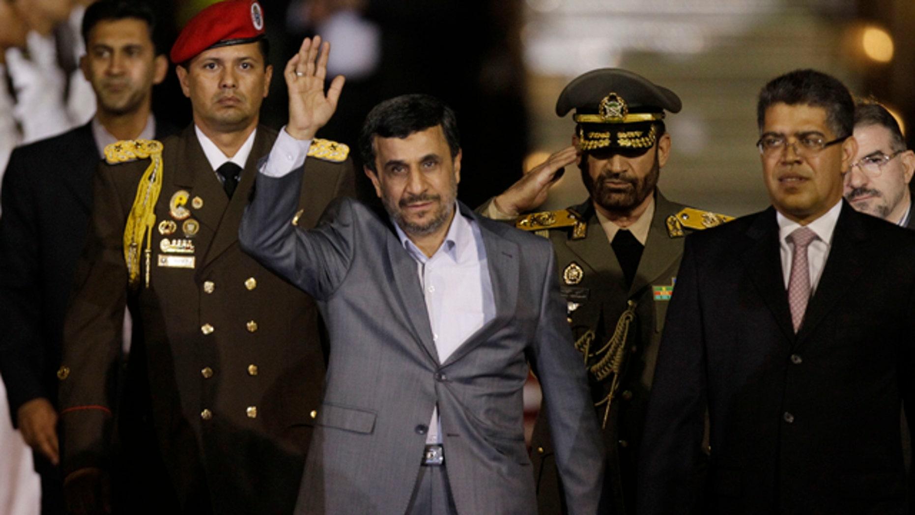 Jan. 8, 2012: Iran's President Mahmoud Ahmadinejad waves upon his arrival at the international airport in Maiquetia, Venezuela.