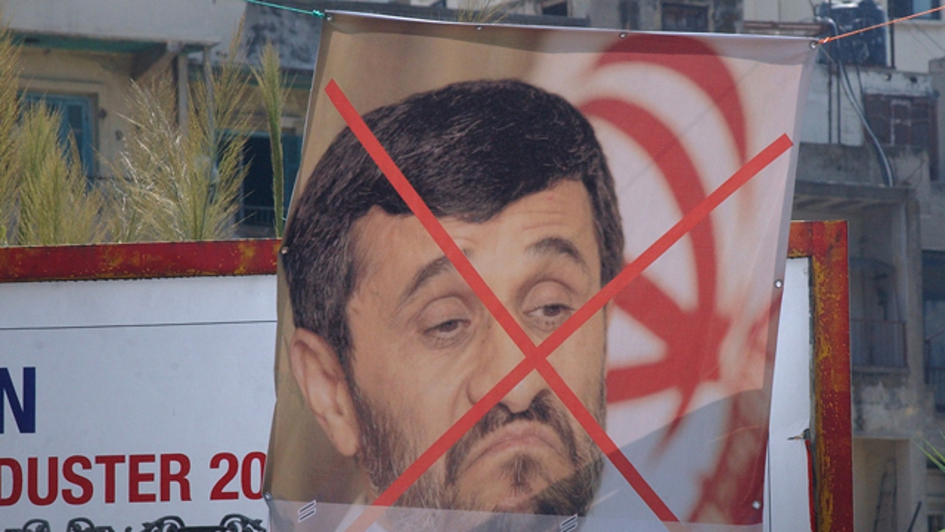 Oct. 7, 2010: A poster protesting Iranian President Mahmoud Ahmadinejad's visit to Lebanon, which begins October 13. Lebanon is a hotbed of Islamic fundamentalism.