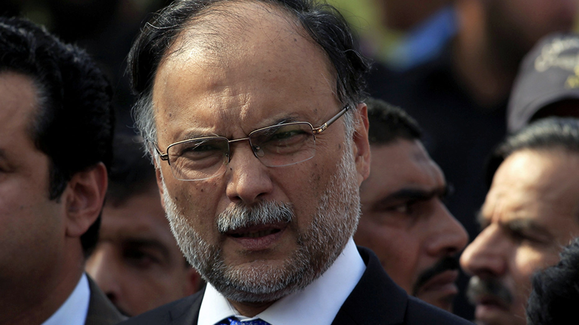 Ahsan Iqbal, pictured in October 2017, was attacked while leaving a public meeting Sunday.