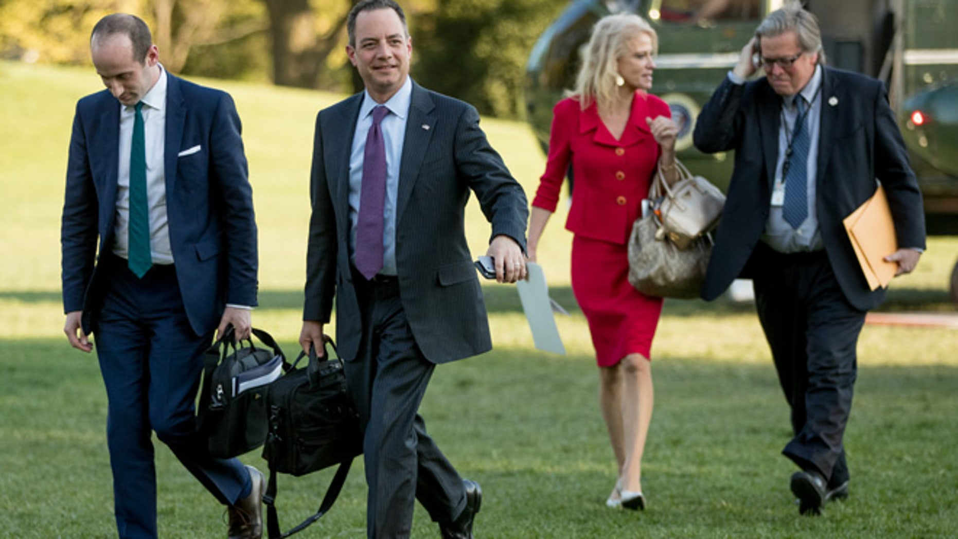 From left, President Donald Trump's White House Senior Adviser Stephen Miller, President Donald Trump's Chief of Staff Reince Priebus, Counselor to the President Kellyanne Conway, and President Donald Trump's White House Senior Adviser Steve Bannon, walk across the South Lawn after President Donald Trump arrives at the White House in Washington, Tuesday, April 18, 2017, after a short trip from Andrews Air Force Base, Md., after speaking at Snap-On Tools in Kenosha, Wis. (AP Photo/Andrew Harnik)