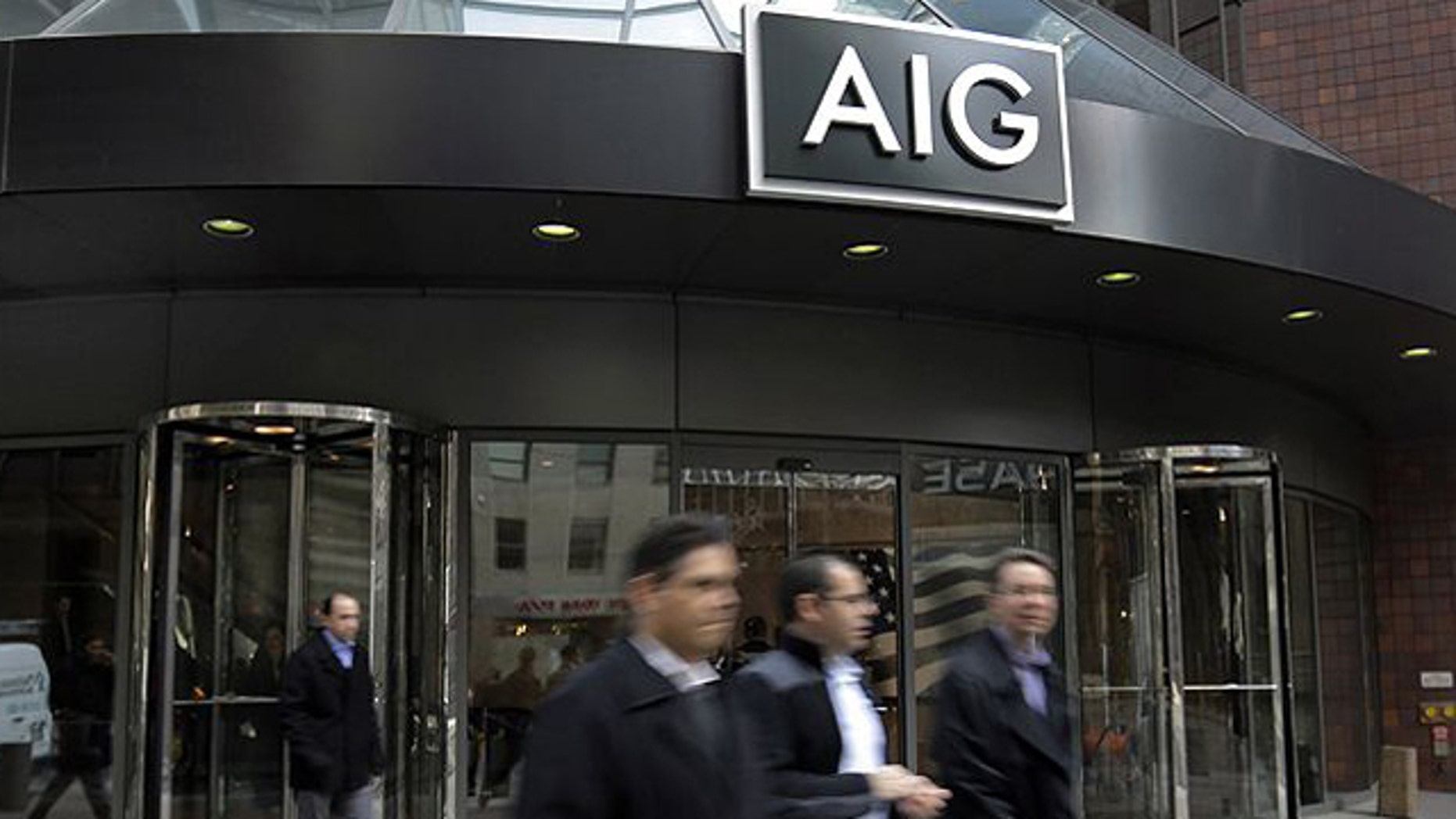 Jan. 8, 2013: People pass the AIG building in New York.