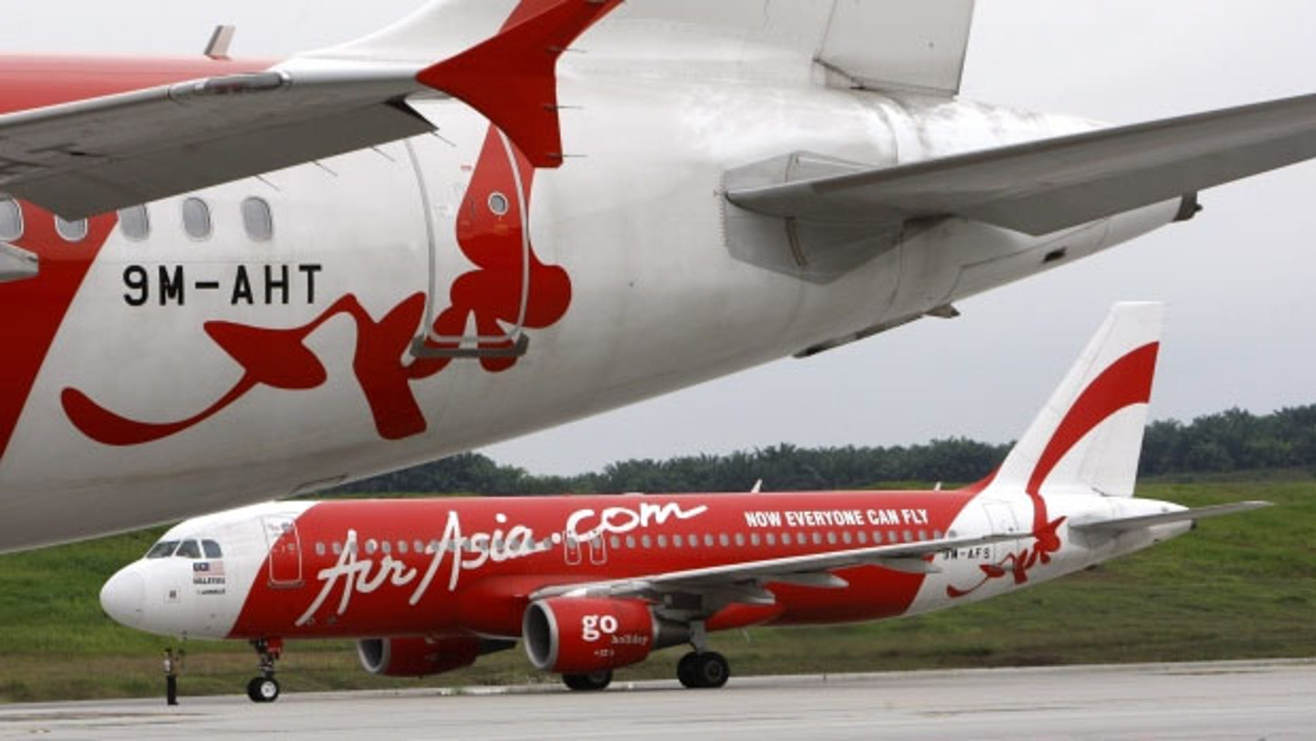 AirAsia planes lineup on a runway (AP/File)