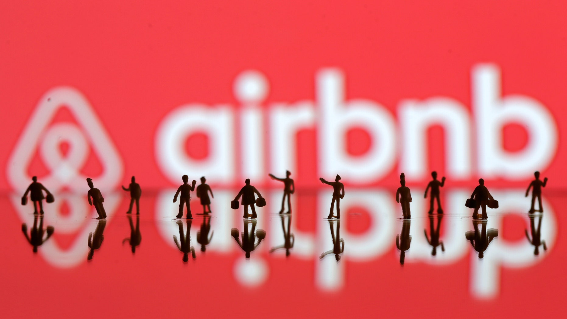File photo: A 3D printed people's models are seen in front of a displayed Airbnb logo in this illustration taken, June 8, 2016. (REUTERS/Dado Ruvic)