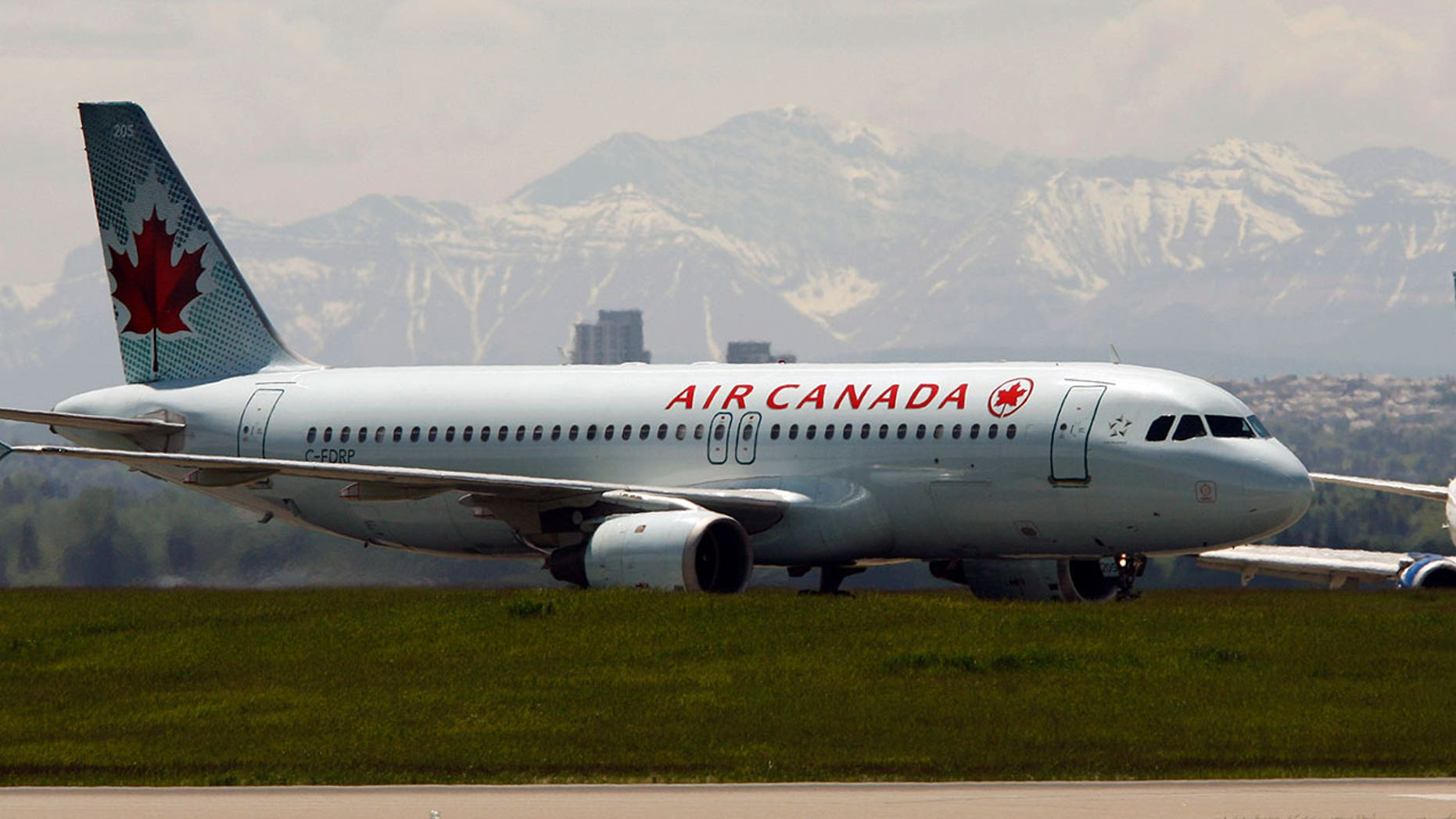 An Air Canada flight almost landed on a crowded taxiway filled with passenger planes.
