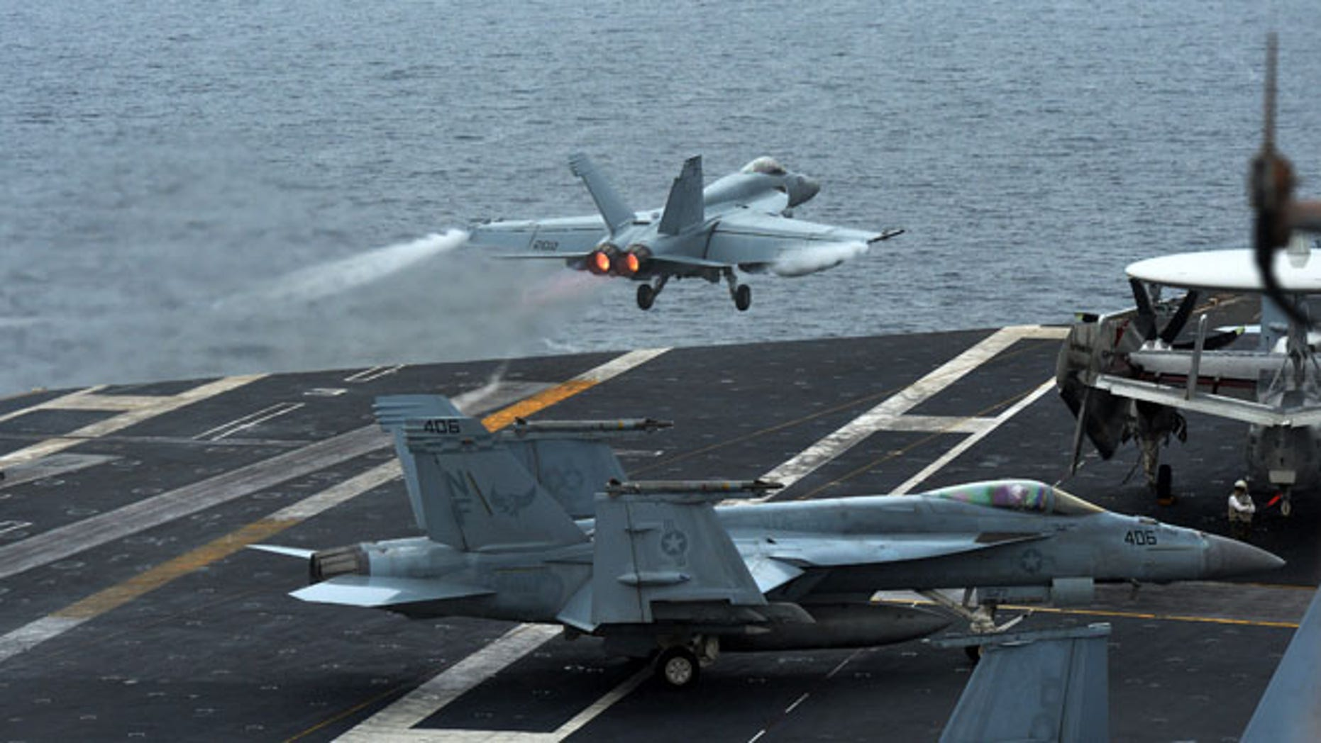 A U.S. F18 Hornet fighter attack aircraft is launched off the deck of the U.S. nuclear-powered aircraft carrier, USS George Washington during a military exercise off South Korea's West Sea, Wednesday, July 16, 2014.