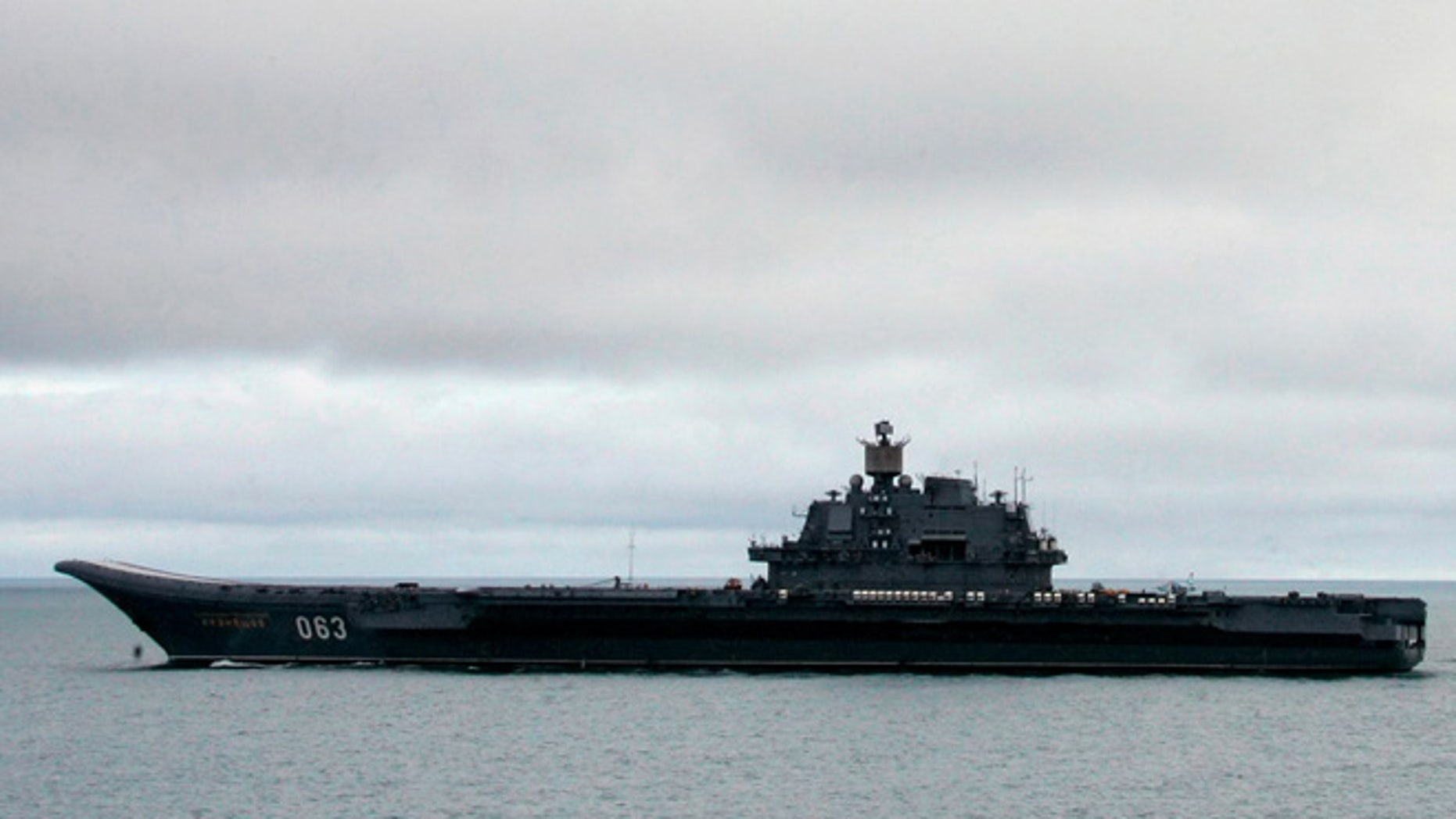 FILE: The Russian aircraft carrier Admiral Kuznetsov, seen here in the Barents Sea, is Moscow's largest and is being sent to the Mediterranean after military buildup by the US.