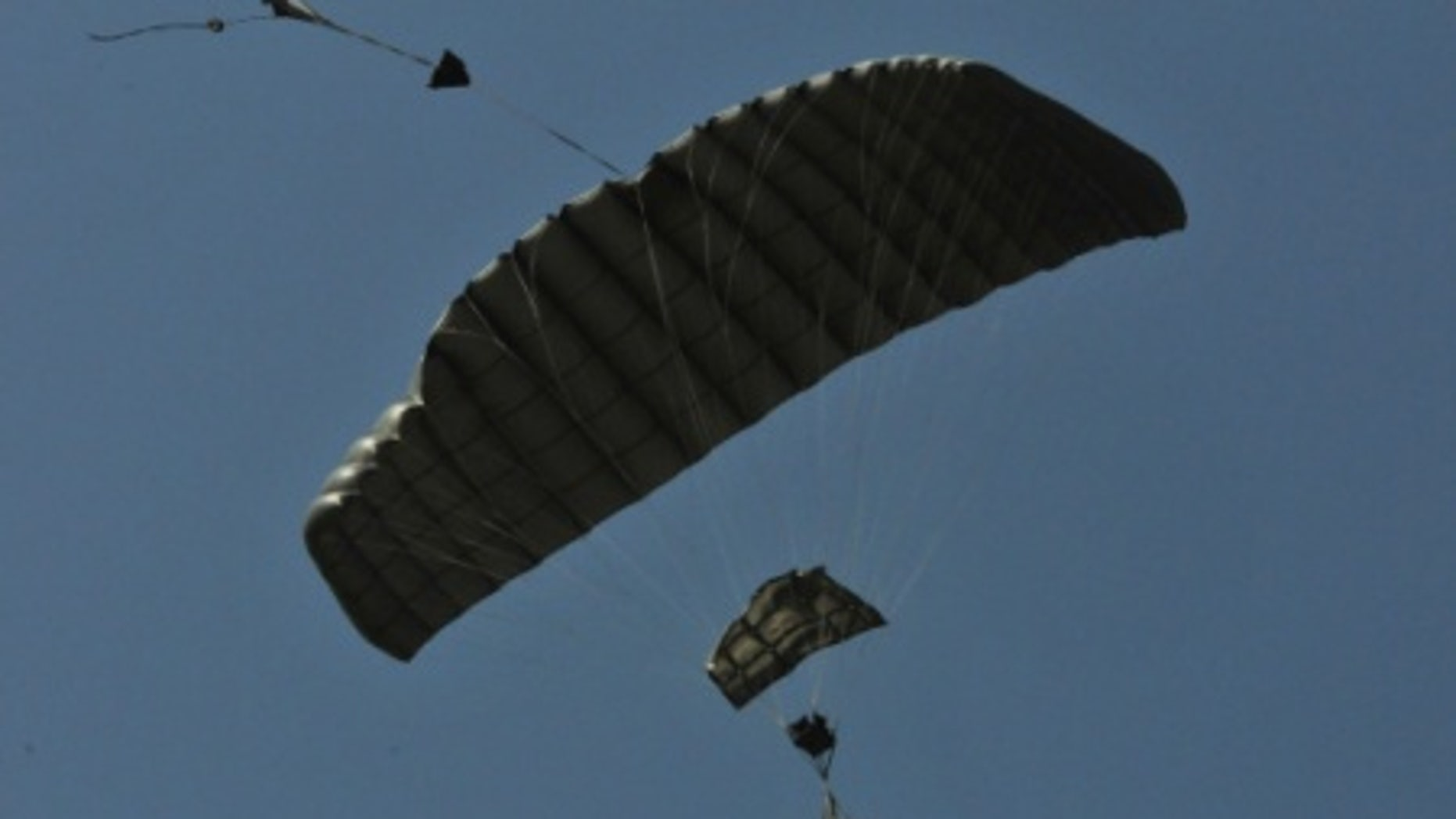 File photo - A joint precision airdrop system (JPADS) guides itself to the ground following its drop from a C-130 aircraft at Normandy Drop Zone in Fort Bragg, N.C., May 23, 2013. (U.S. Army photo by Sgt. Amanda Tucker/Released)