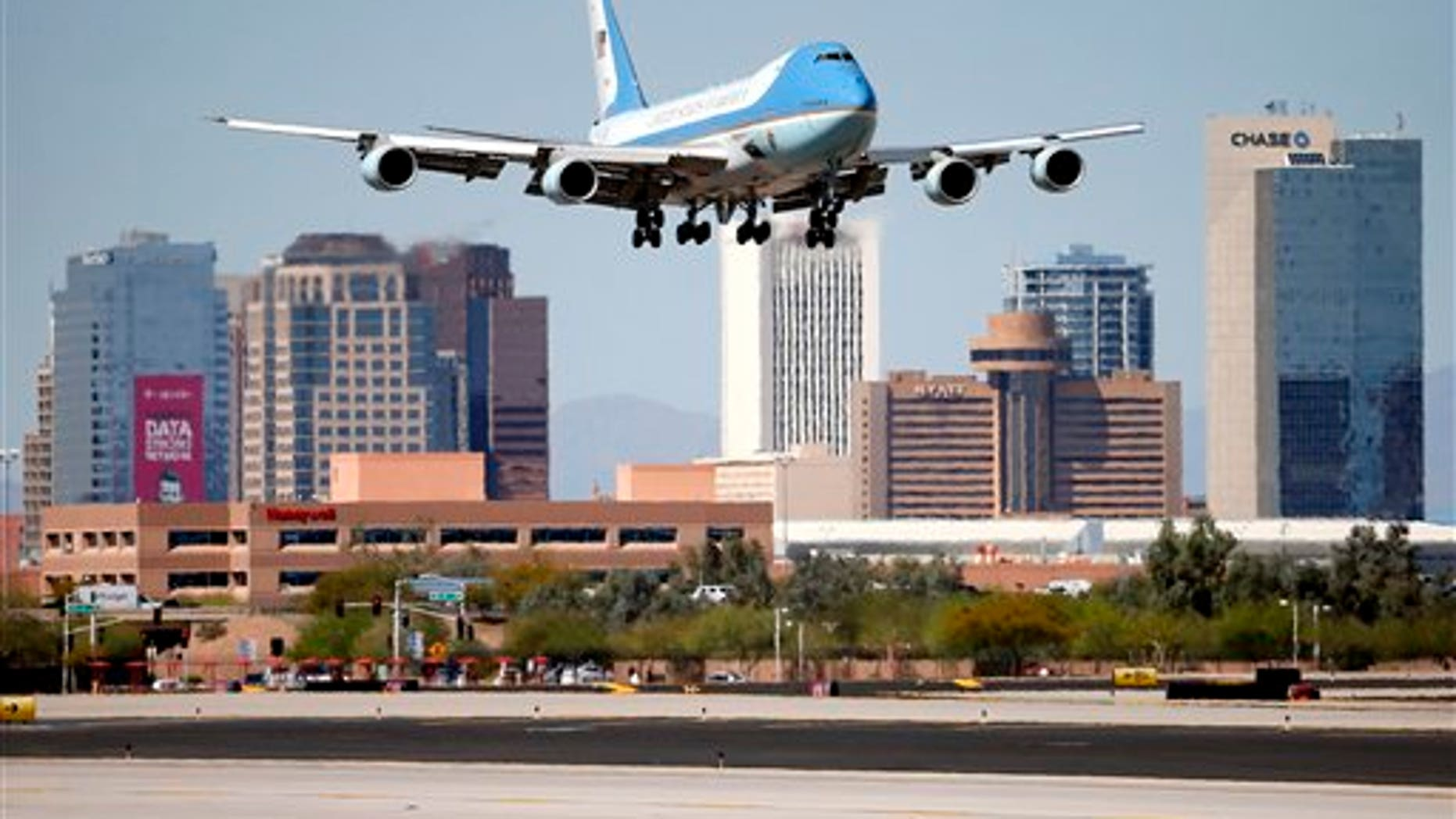 Air Force One arrives at Sky Harbor International Airport, Friday, March 13, 2015, in Phoenix. (AP Photo/Matt York)