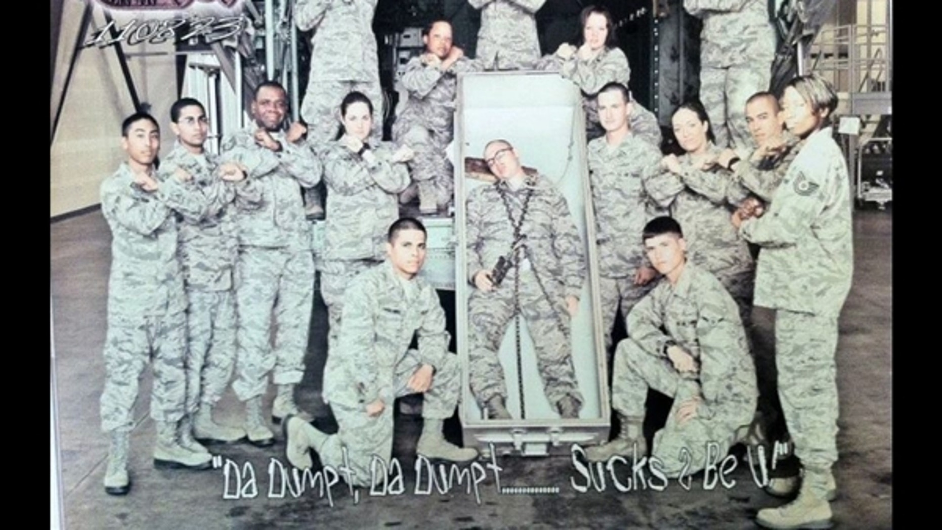 AirForce officials say they are investigating this photo of 15 airmen posing with another airman pretending to be dead and lying in an open casket with a noose around his neck.