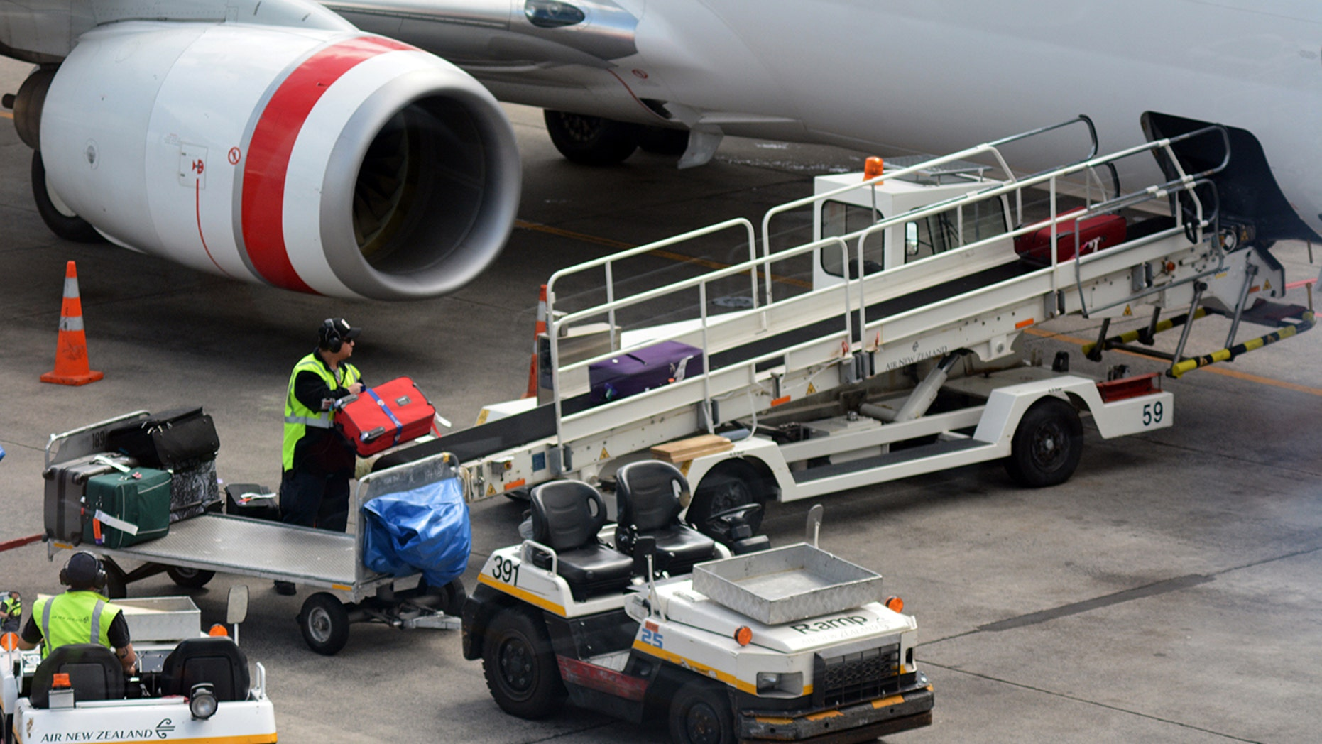 An airport worker has been arrested and charged for stealing contents out of passengers' checked luggage.