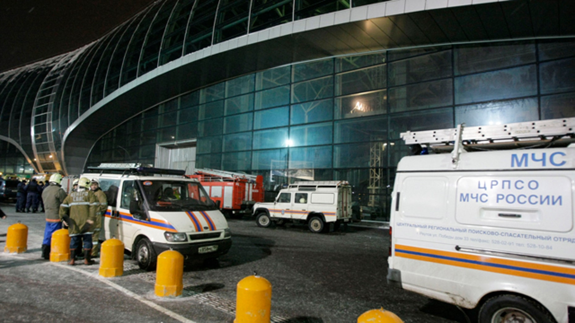 Jan. 24: Fire engine and emergency vehicles are seen outside a terminal at Domodedovo airport, Moscow.