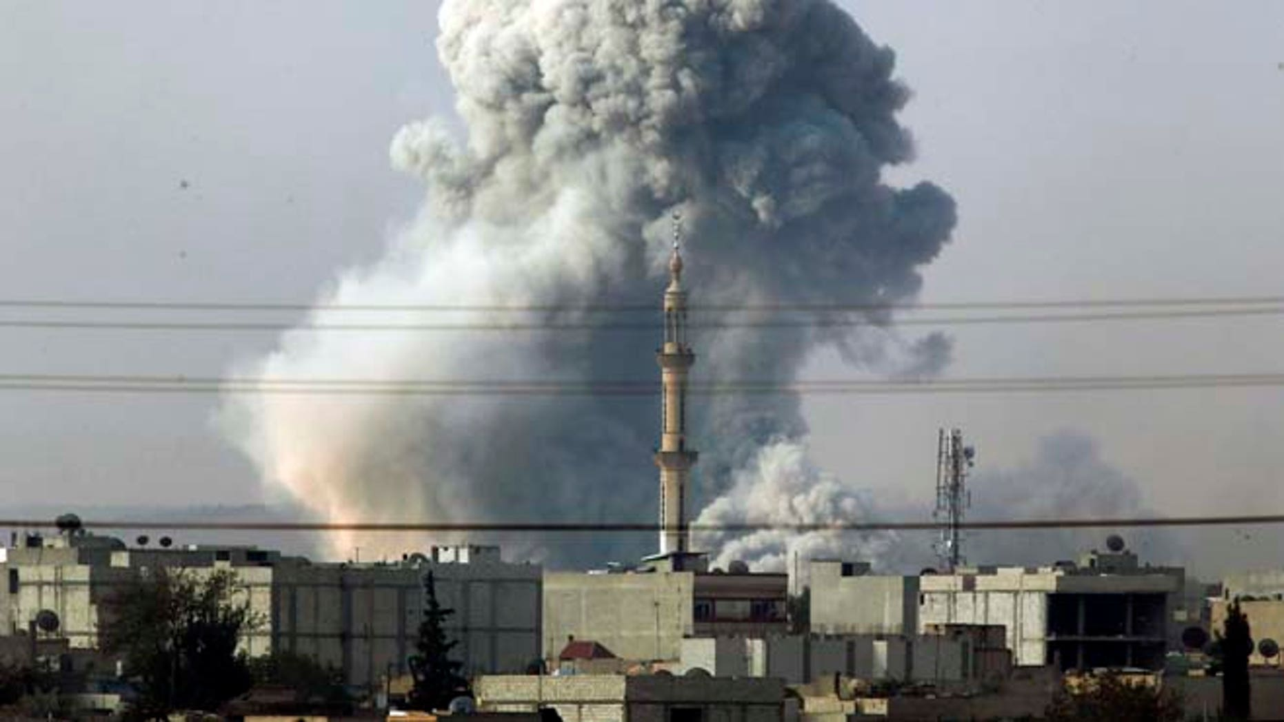 Oct. 14, 2014: Smoke rises following an airstrike by the U.S.-led coalition in Kobani, Syria as fighting continues between Syrian Kurds and the militants of Islamic State group, as seen from Mursitpinar, on the outskirts of Suruc, at the Turkey-Syria border. Kobani, also known as Ayn Arab, and its surrounding areas, has been under assault by extremists of the Islamic State group since mid-September and is being defended by Kurdish fighters.
