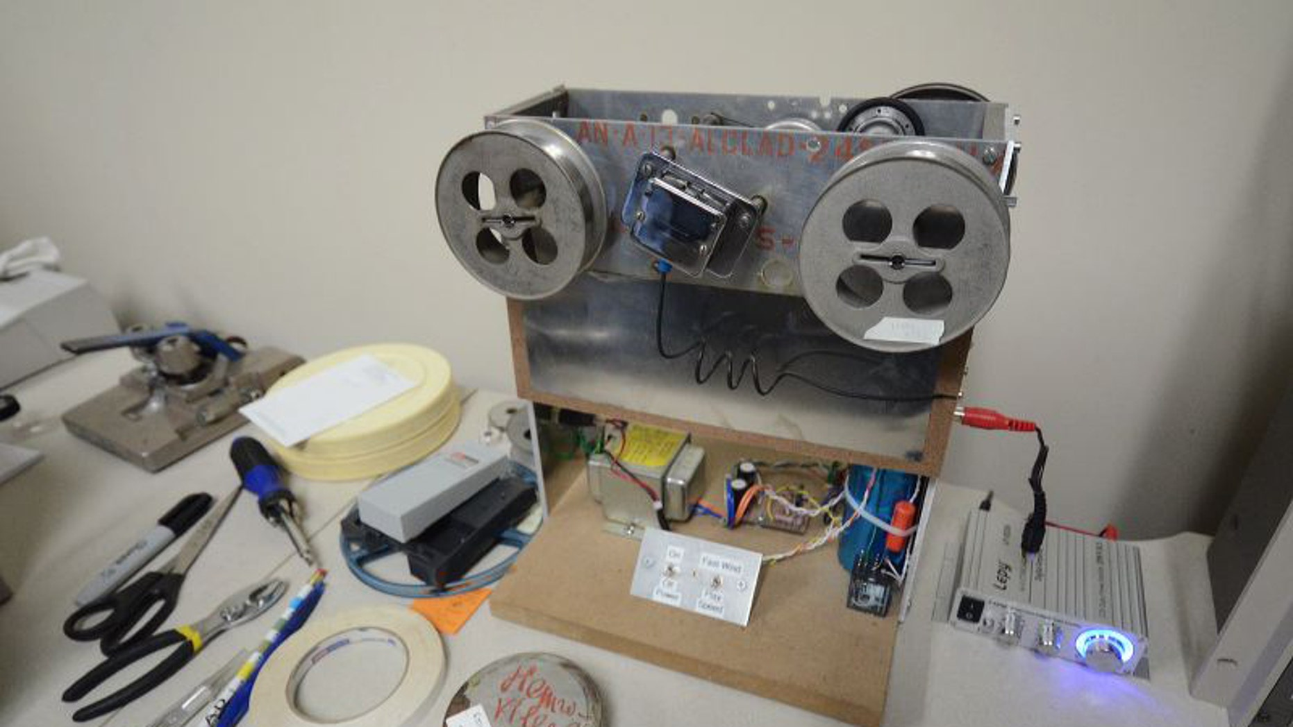 The wire recorder that, once modernized, released the voices recorded in song at a refugee camp in Henonville, France, decades earlier (The University of Akron).