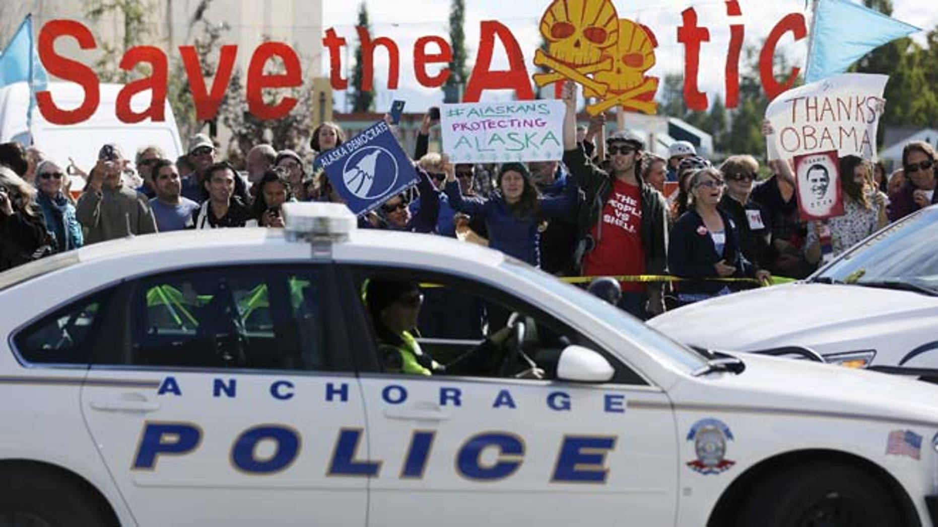 Aug. 31: People protesting against Shell Oil greet President Obama's motorcade as he arrives to deliver remarks to the GLACIER Conference in Anchorage, Alaska.