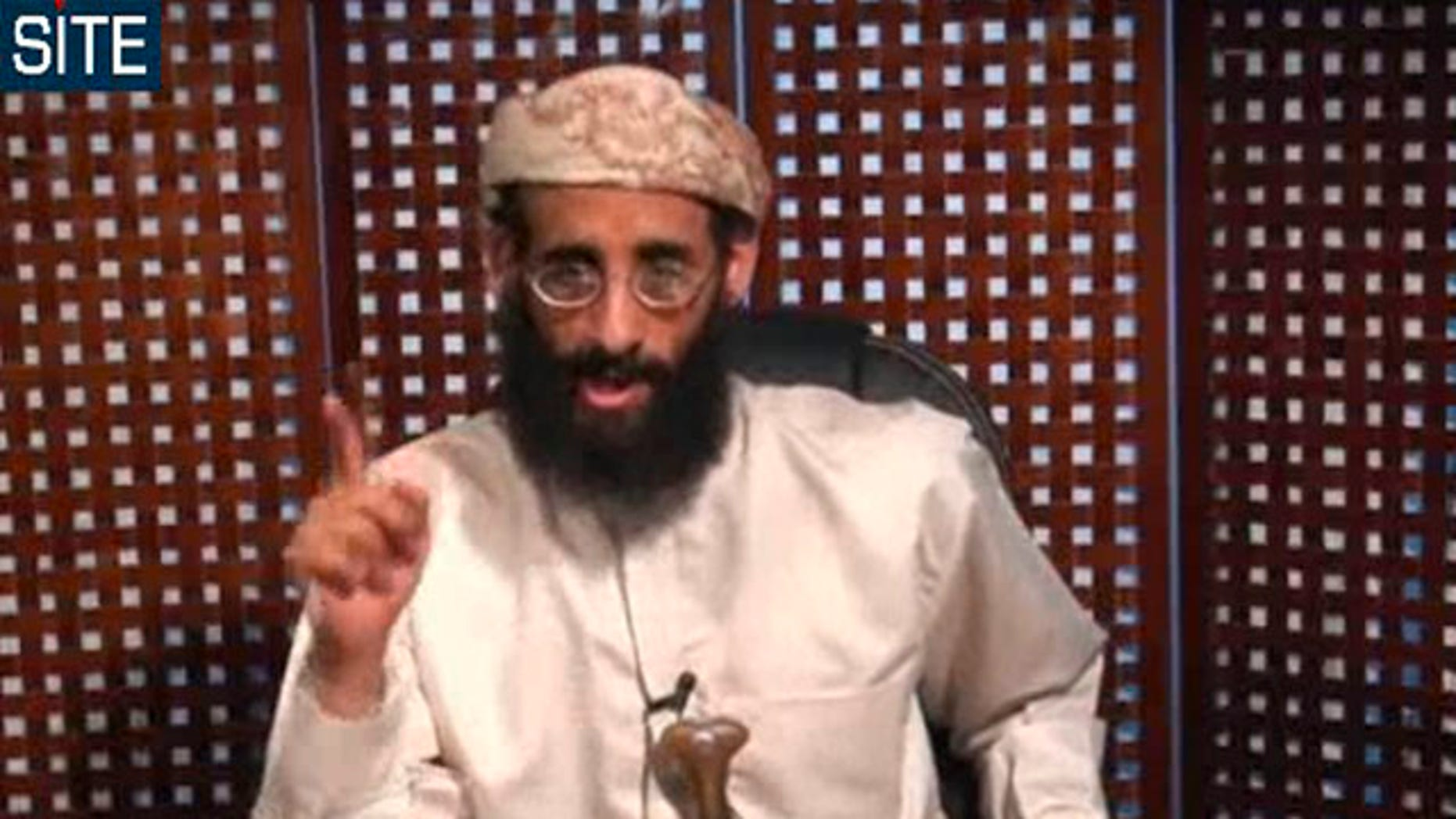 In this Nov. 8, 2010 file photo taken from video and released by SITE Intelligence Group, Anwar al-Awlaki speaks in a video message posted on radical websites.