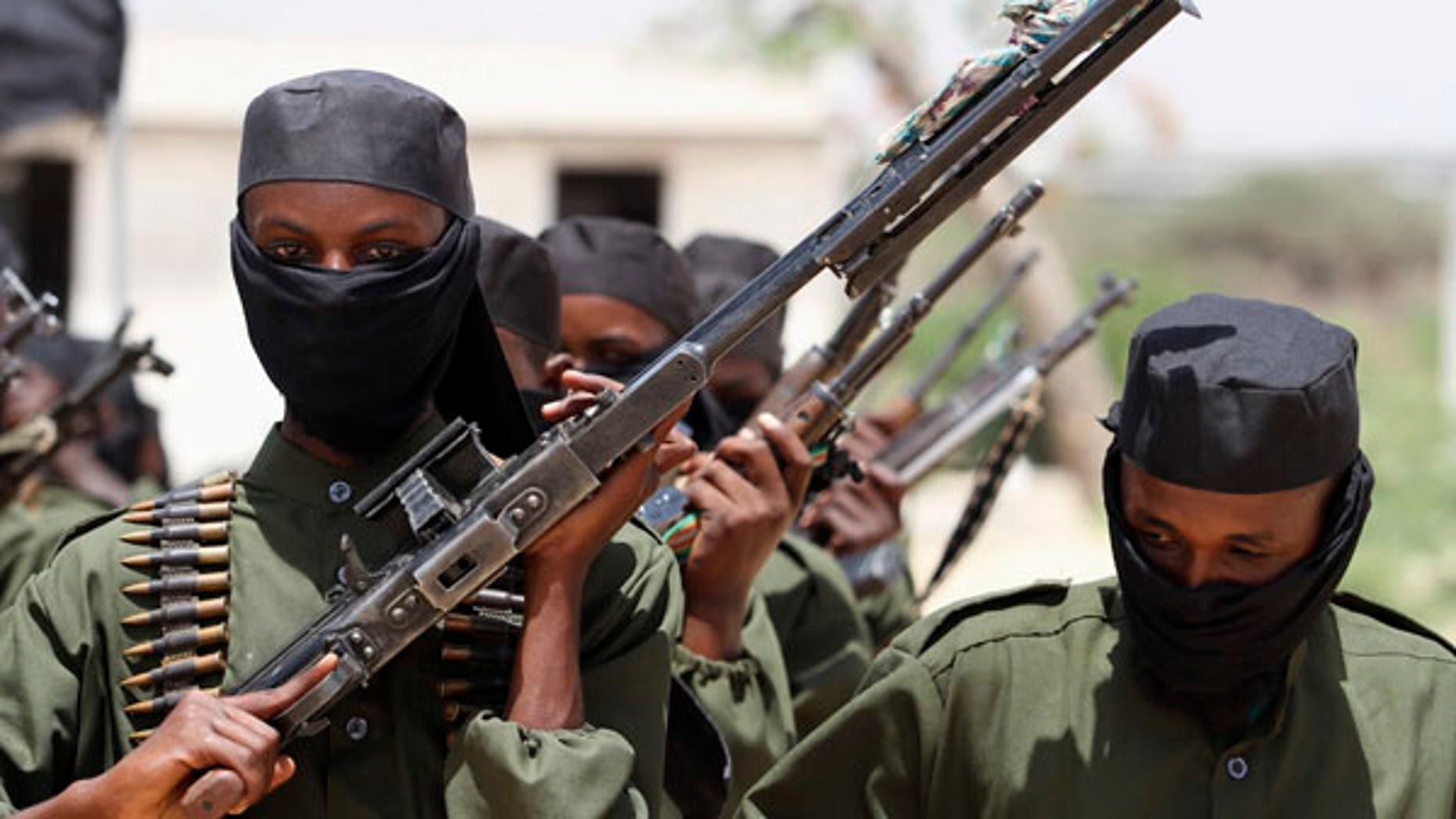 New recruits from the al-Shabaab terror group march during a parade.