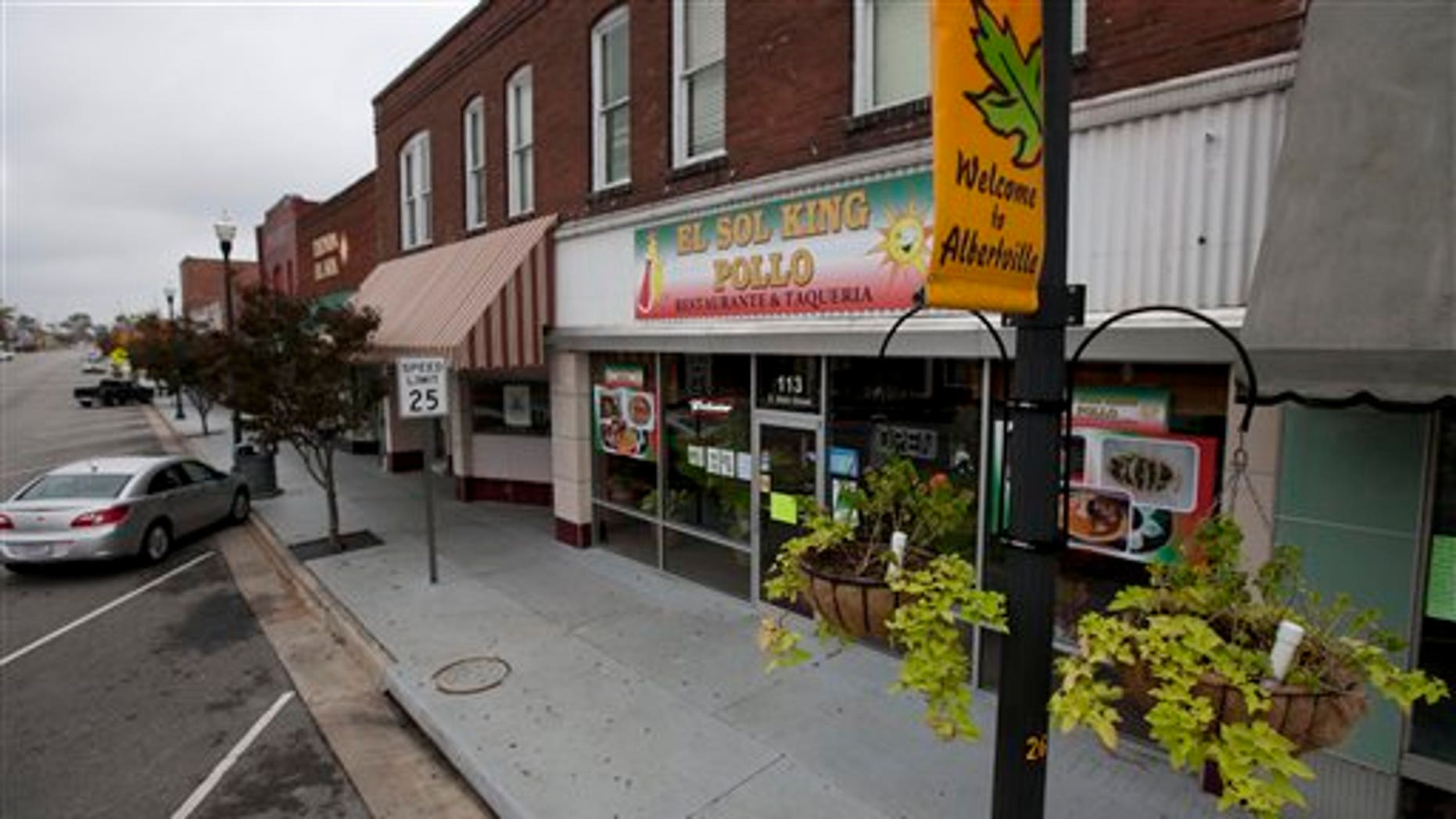 A row of Hispanic owned businesses are closed in Albertville, Ala., Wednesday, Oct. 12, 2011. Dozens of businesses across the state shut down as Hispanics took a day off from work to protest against Alabama's tough new immigration law. (AP Photo/Dave Martin)