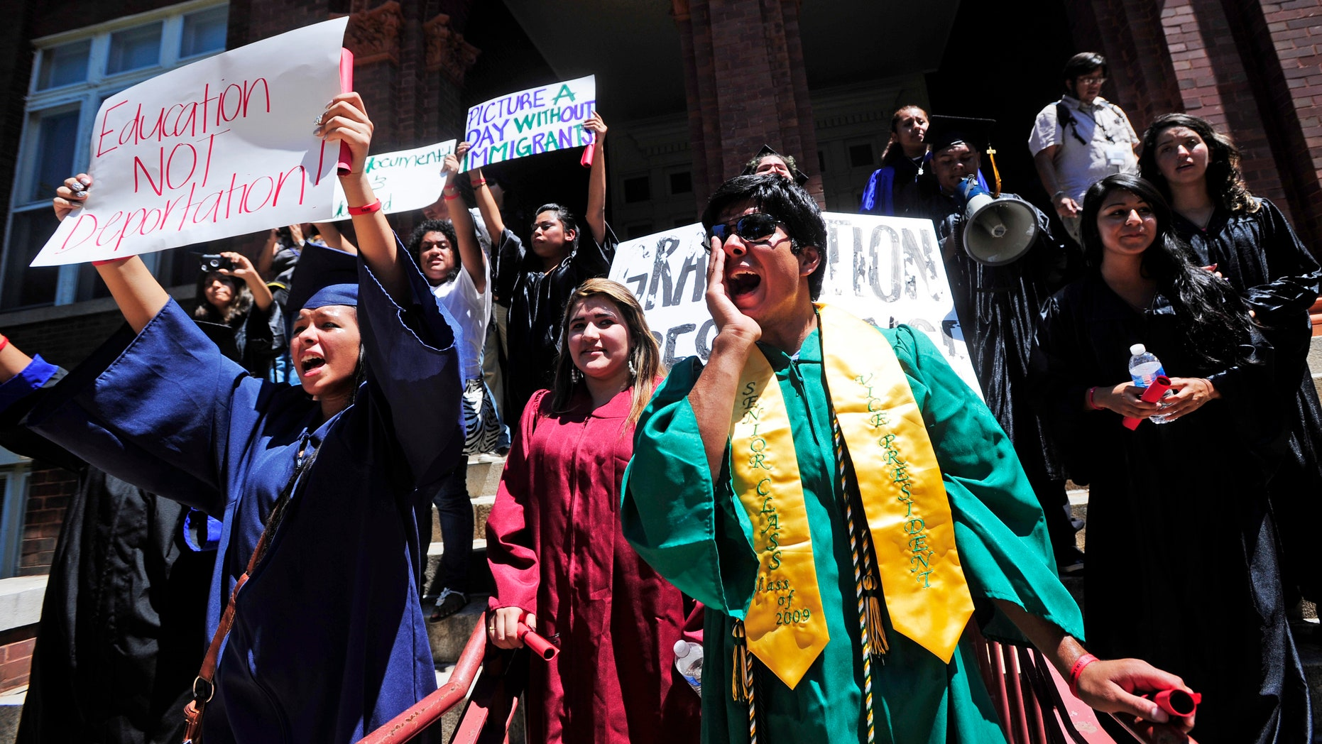 Aug. 23: Gustavo Madrigal, right, shouts outside the admissions office during a protest at the University of Georgia. The group gathered to protest a new university system policy on the admission of undocumented immigrants, the latest in a string of demonstrations staged in recent months in response to the new immigration policy.