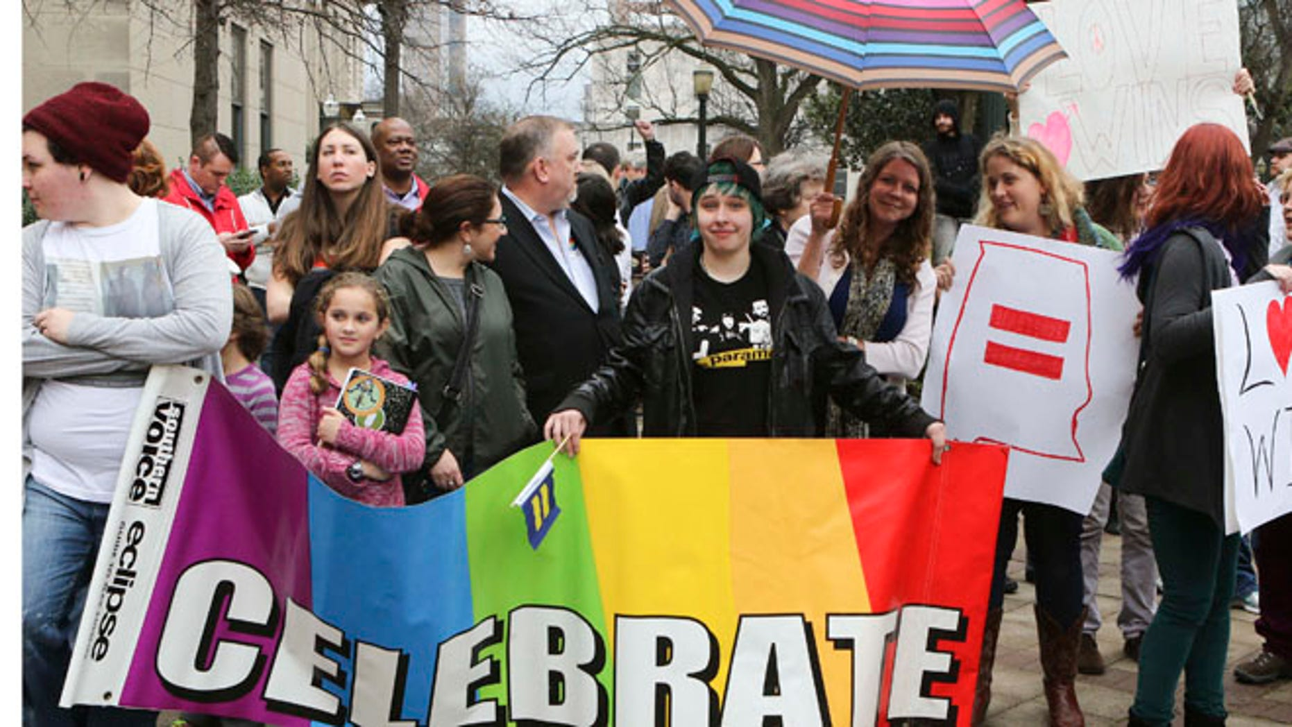 Feb. 9, 2015: Supporters of same-sex marriage hold signs outside the Jefferson County Courthouse in Birmingham, Alabama.