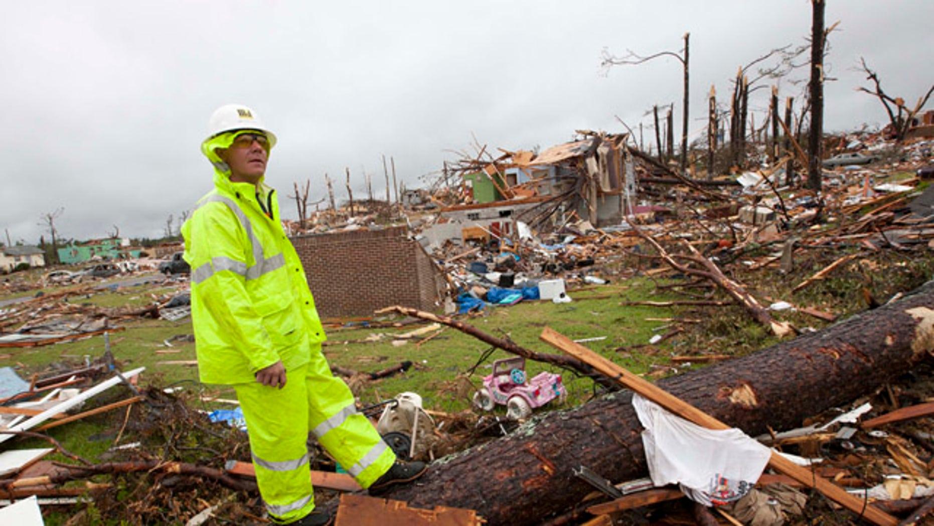 May 3: Lineman Derrick Heisz of Broadhead, Wis., surveys the damage in Pratt City, Ala.